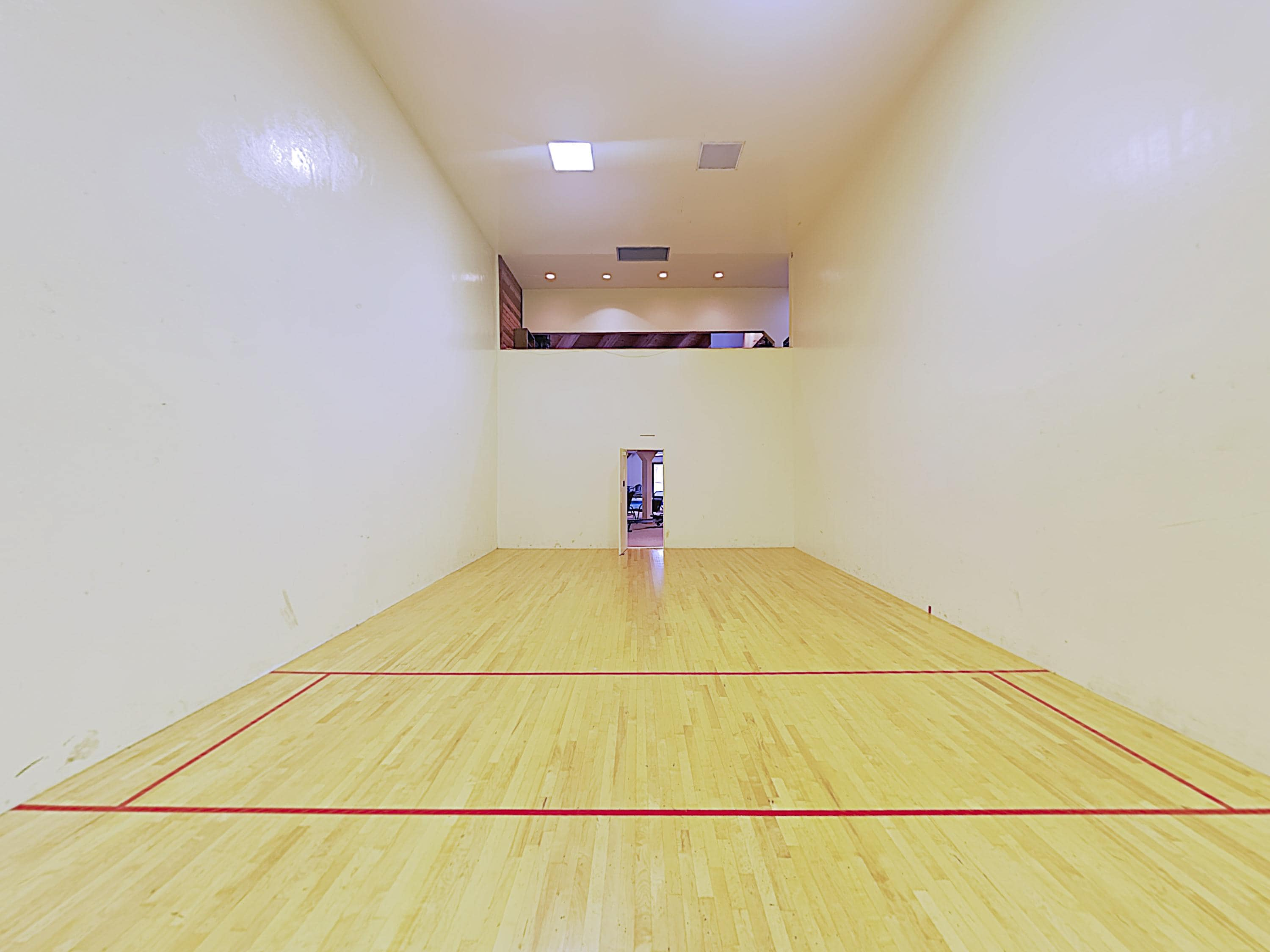 Play a friendly game of racquetball at the community court.