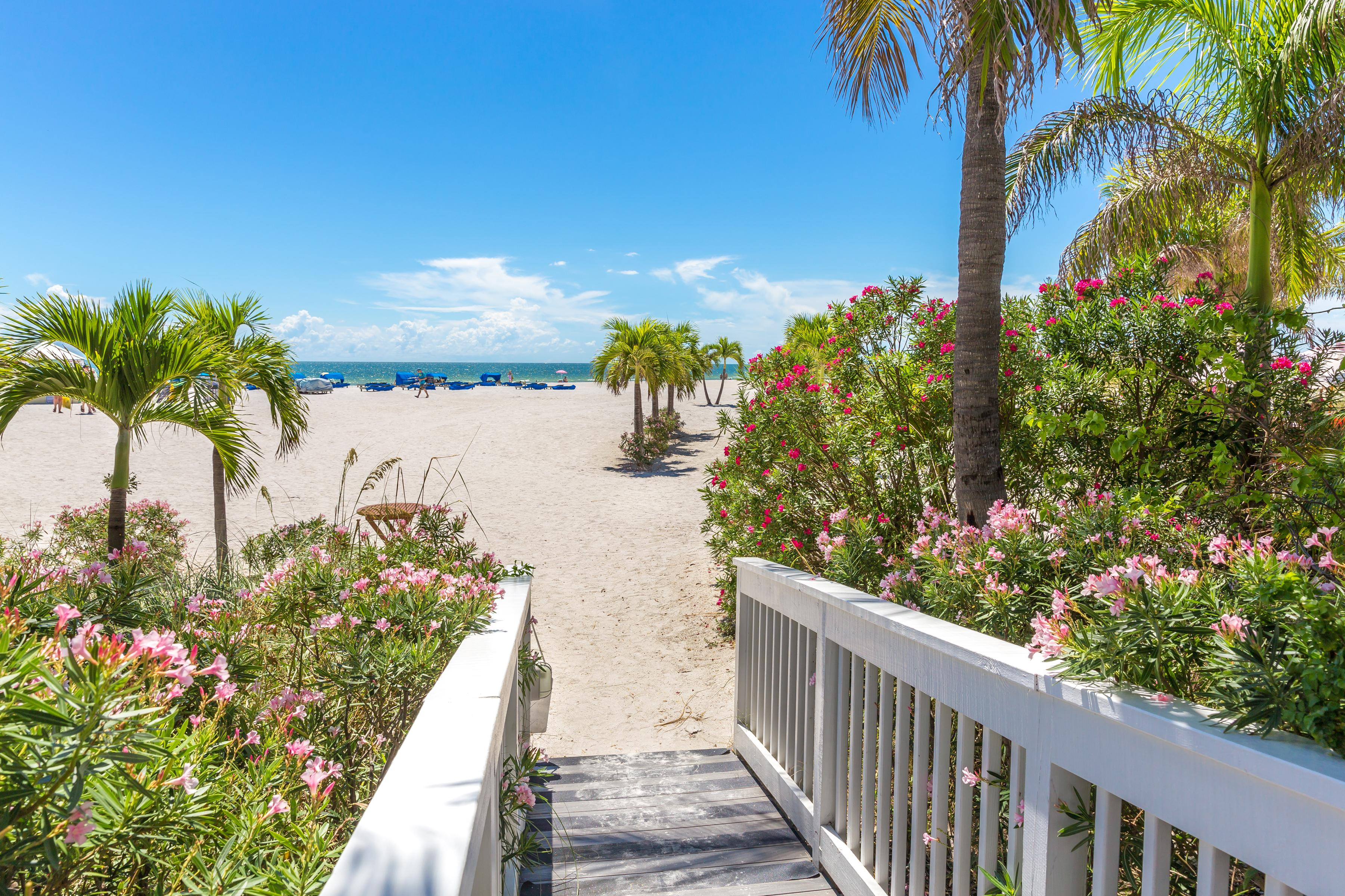 Follow the boardwalk directly to the sandy beach.