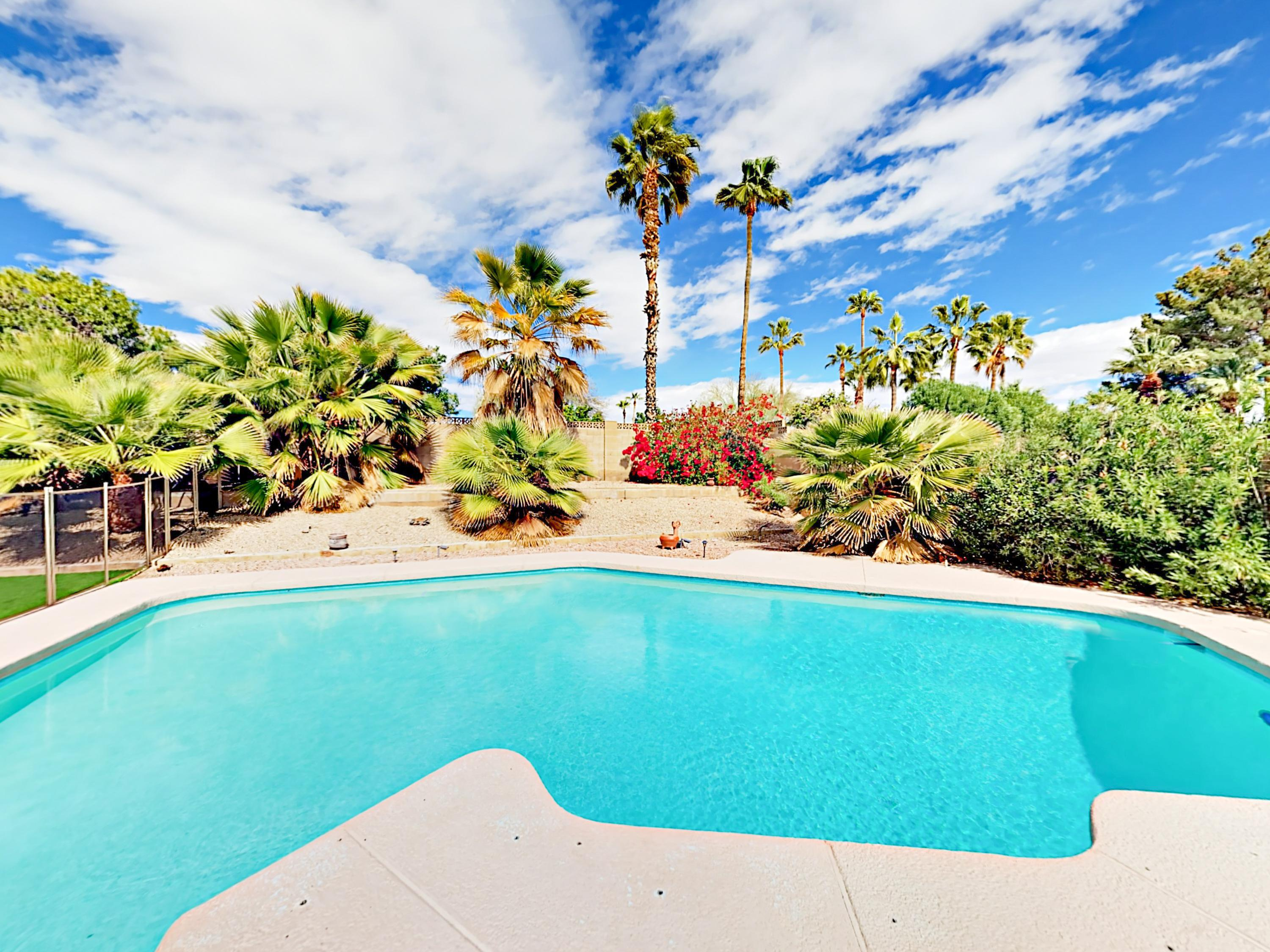 Welcome to Scottsdale! Lush landscaping surrounds the fenced private and heated pool. This inviting home is professionally managed and maintained by TurnKey Vacation Rentals.