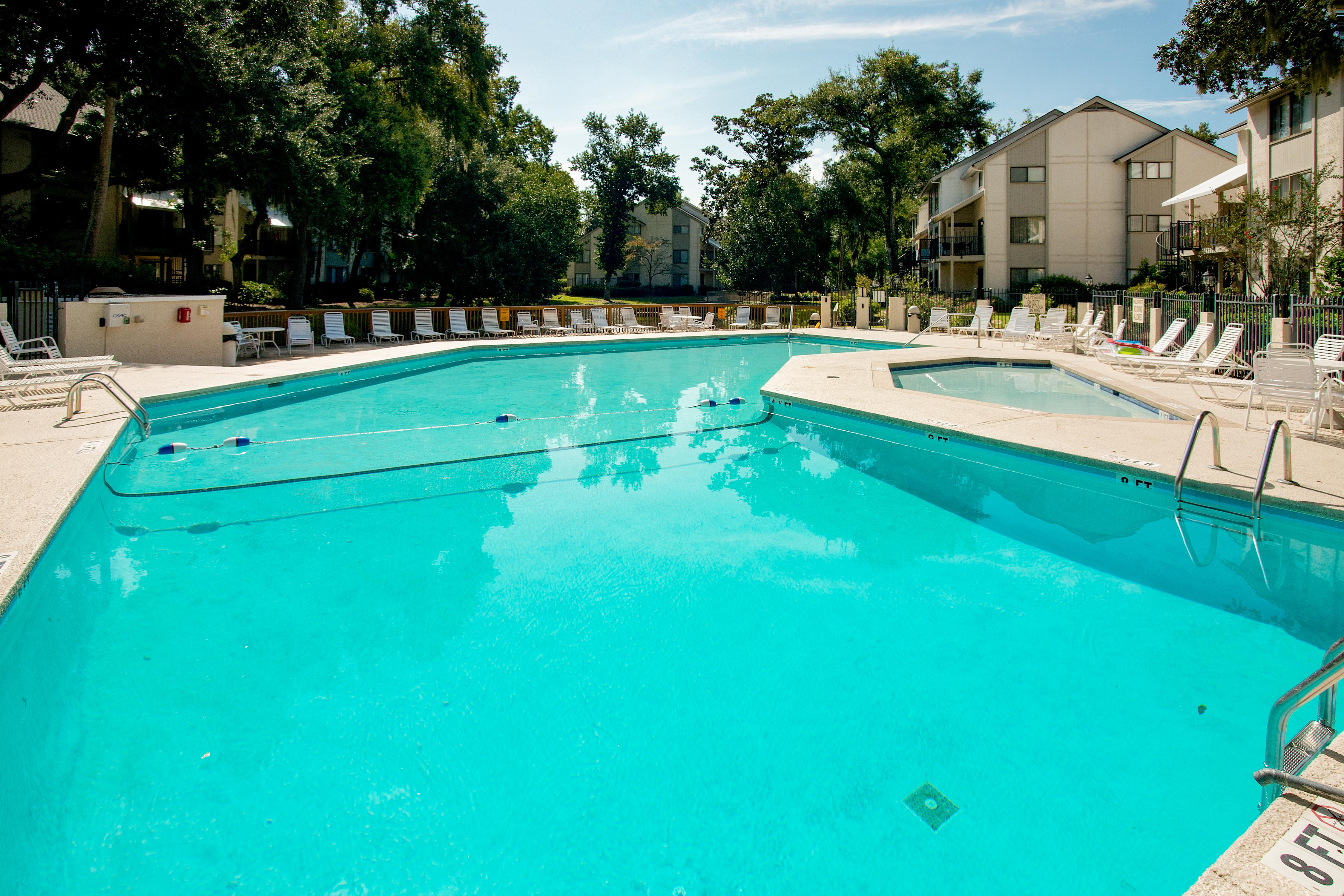 Community amenities include a sparkling pool.