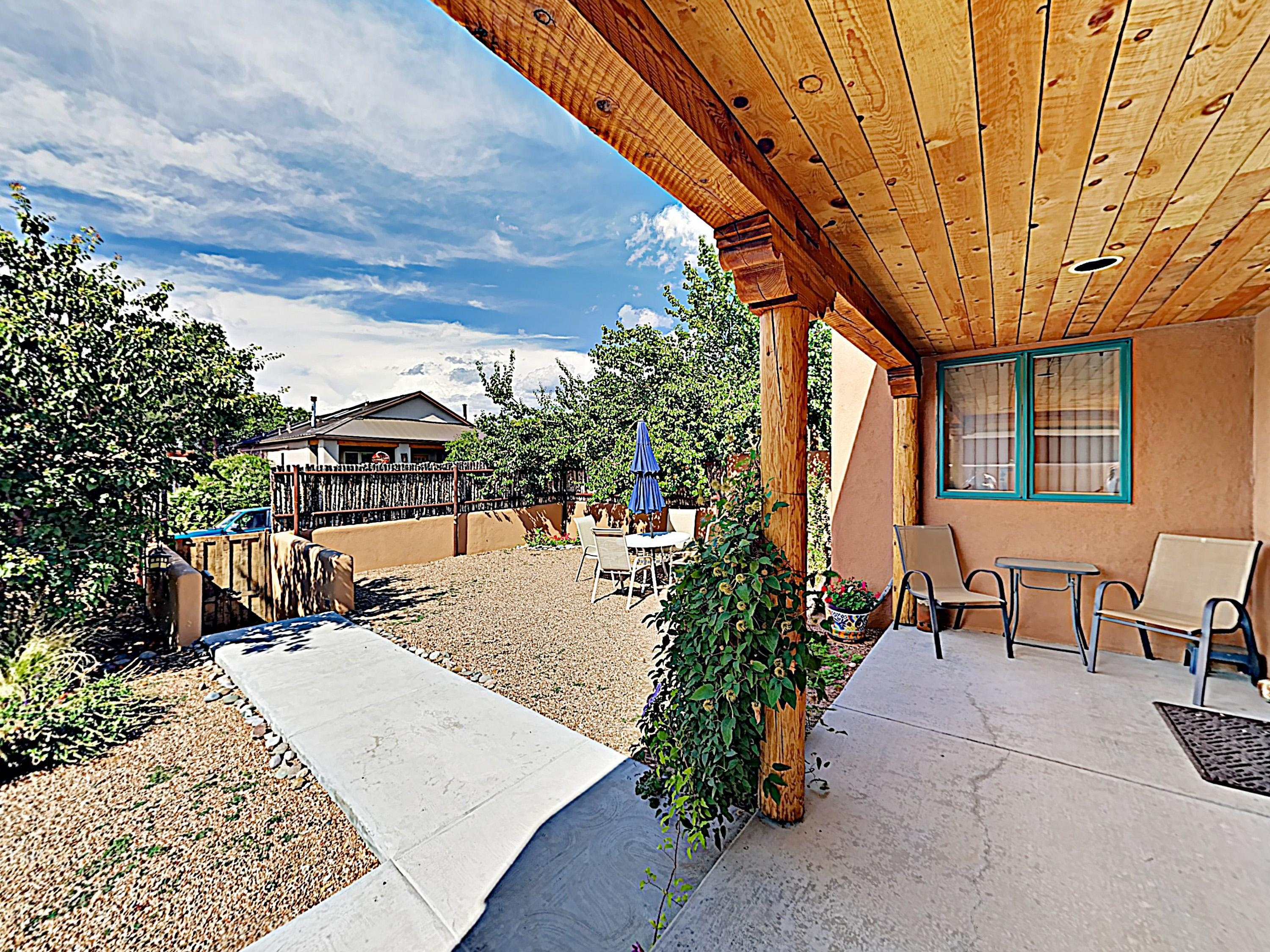 Enjoy the fully enclosed yard with a privacy wall and alfresco dining.