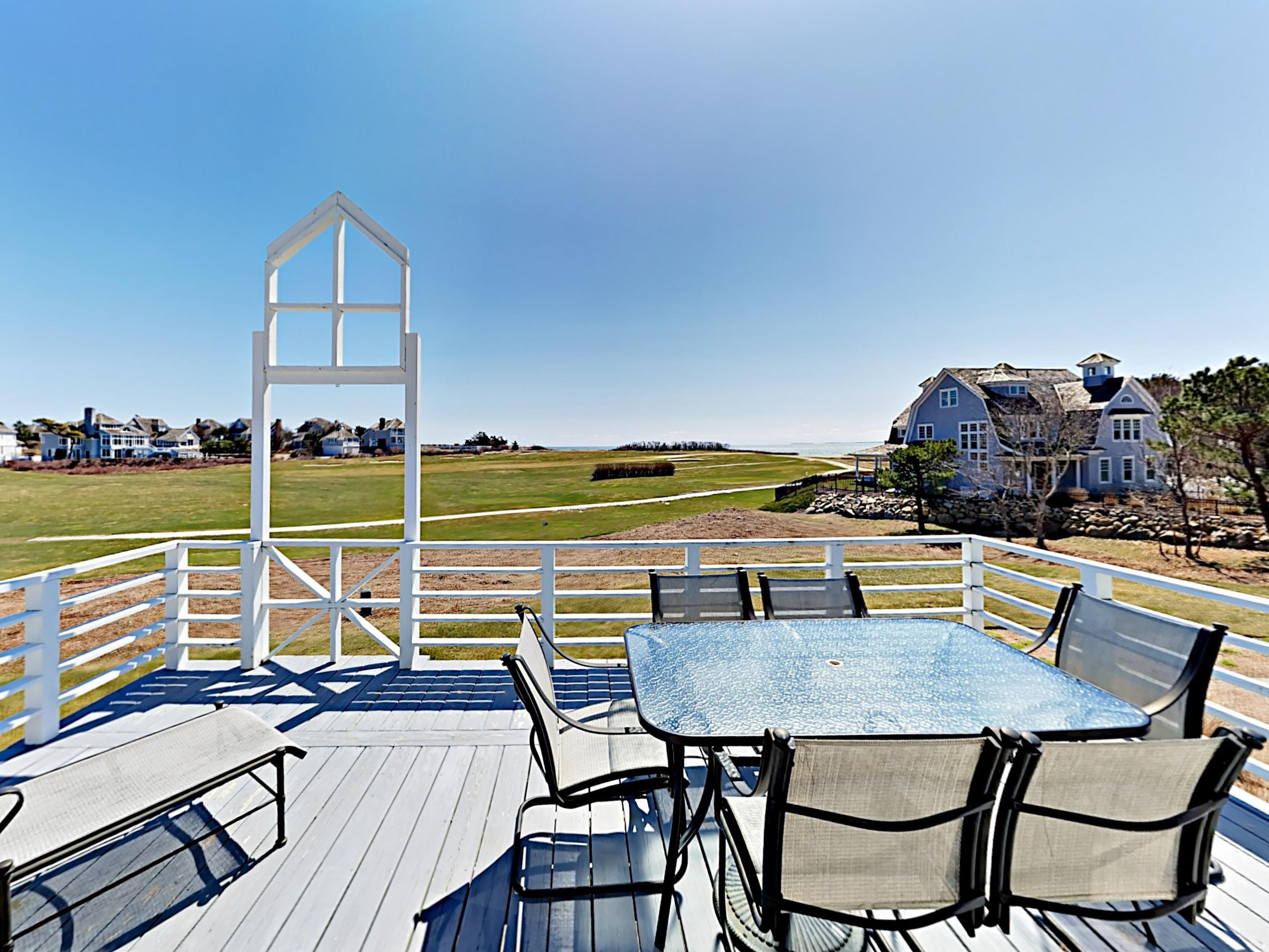 Enjoy dinner al fresco with golf course views on the main deck.
