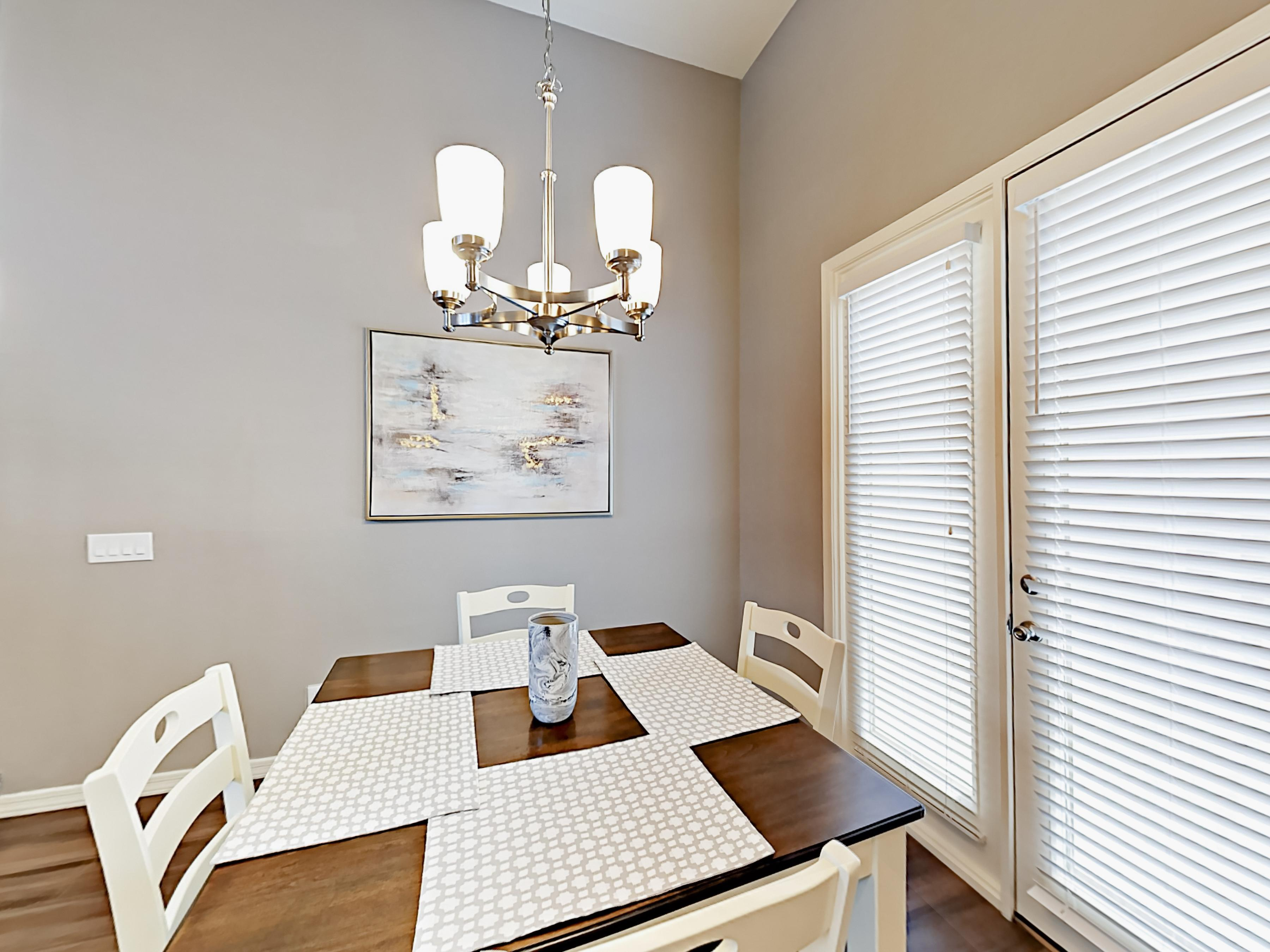 Plenty of natural light in the dining area, thanks to French doors and high ceilings.