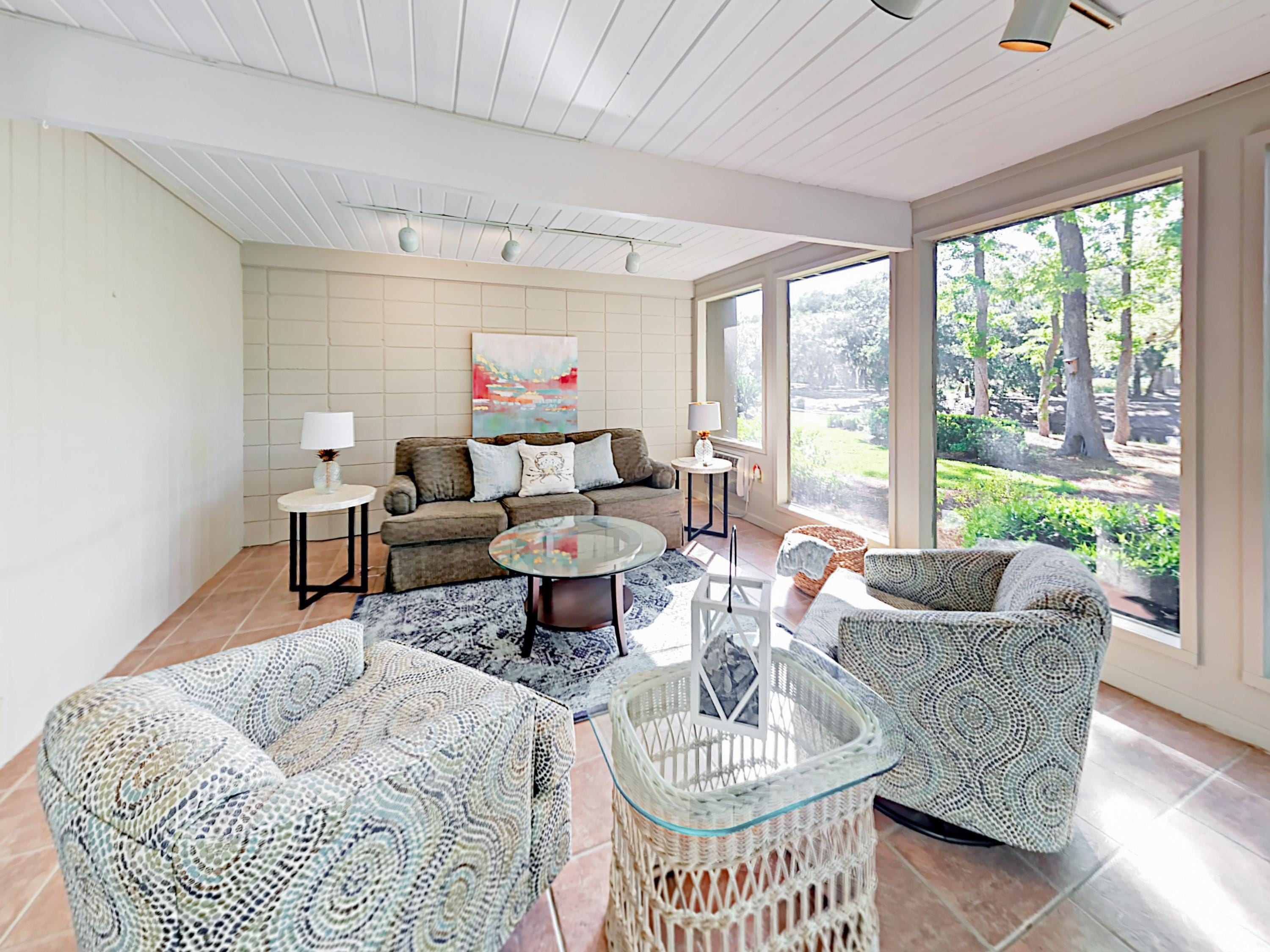 The sunroom offers seating for 6, with lovely lagoon and golf views.