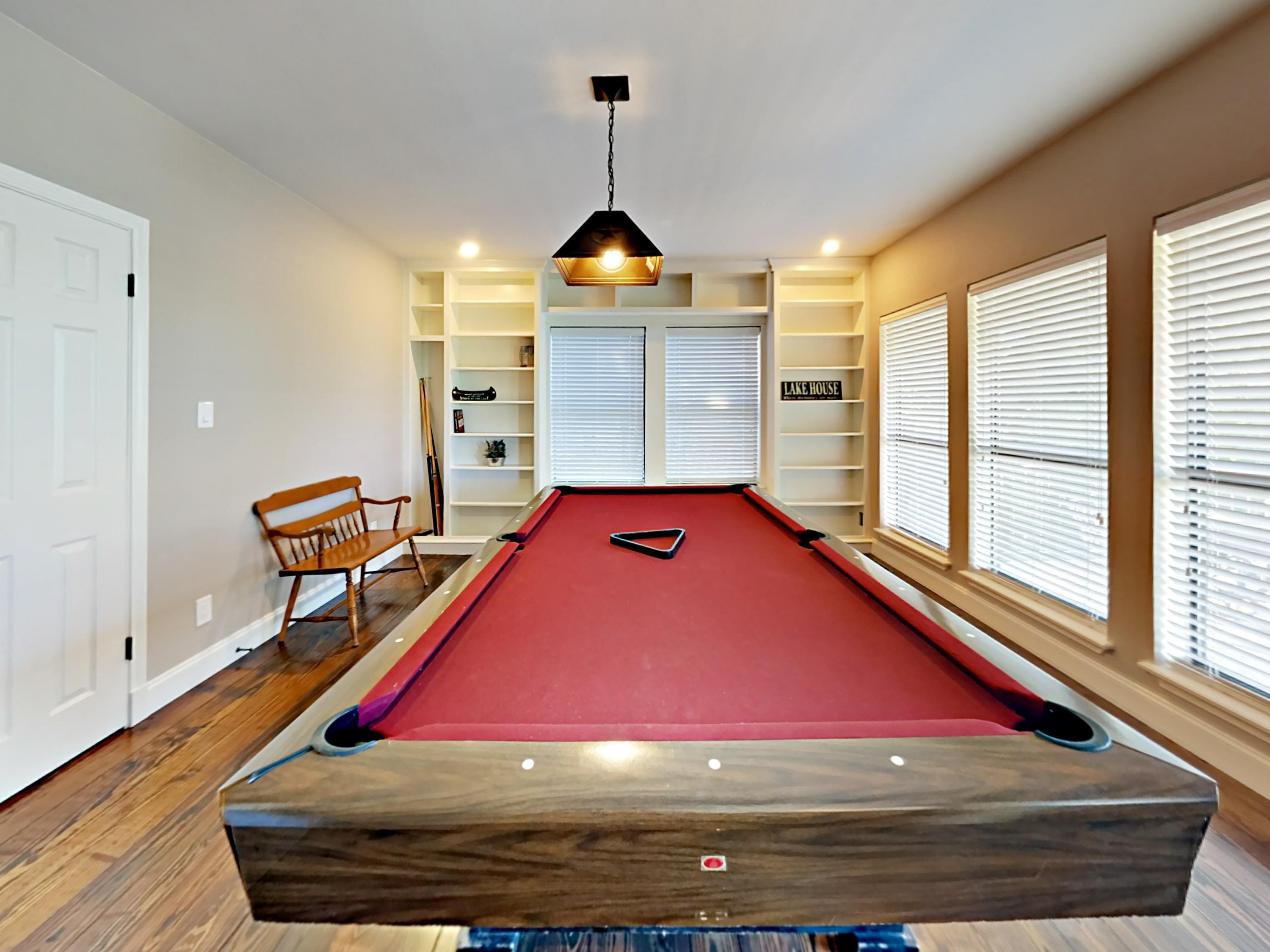 Play billiards in the game room.