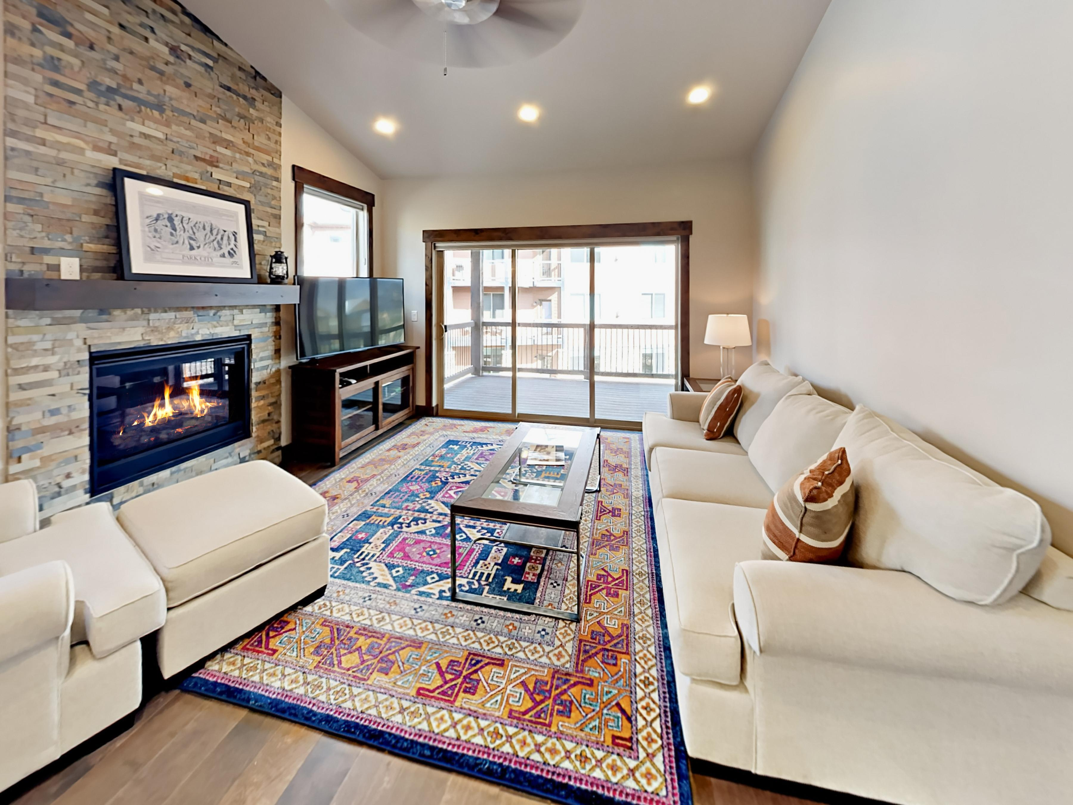 Welcome to Heber City! Sunny living room with seating for 4, gas fireplace, and balcony access.