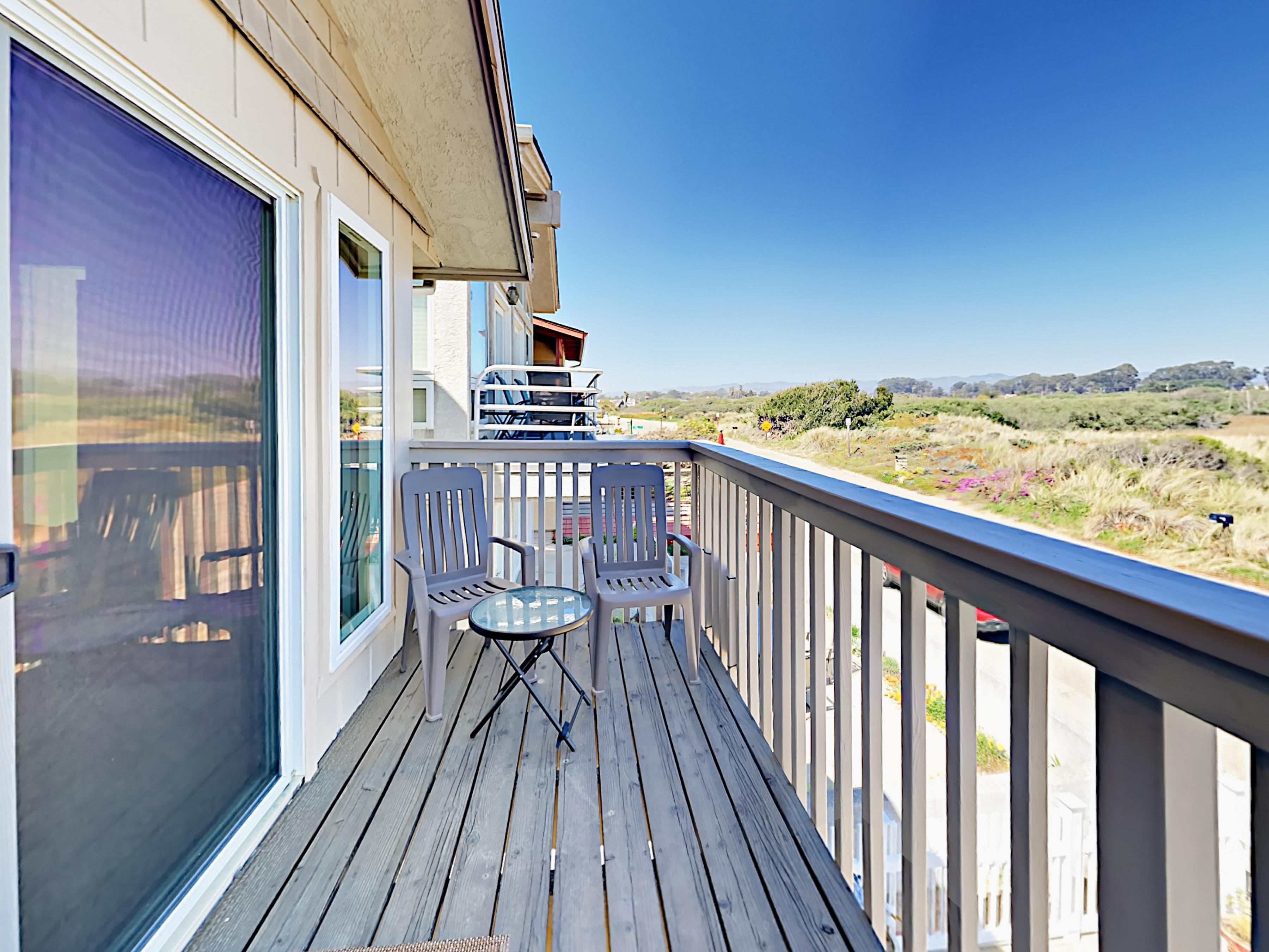 A private balcony offers a nice spot to take in the lush views of the lagoon and dunes.