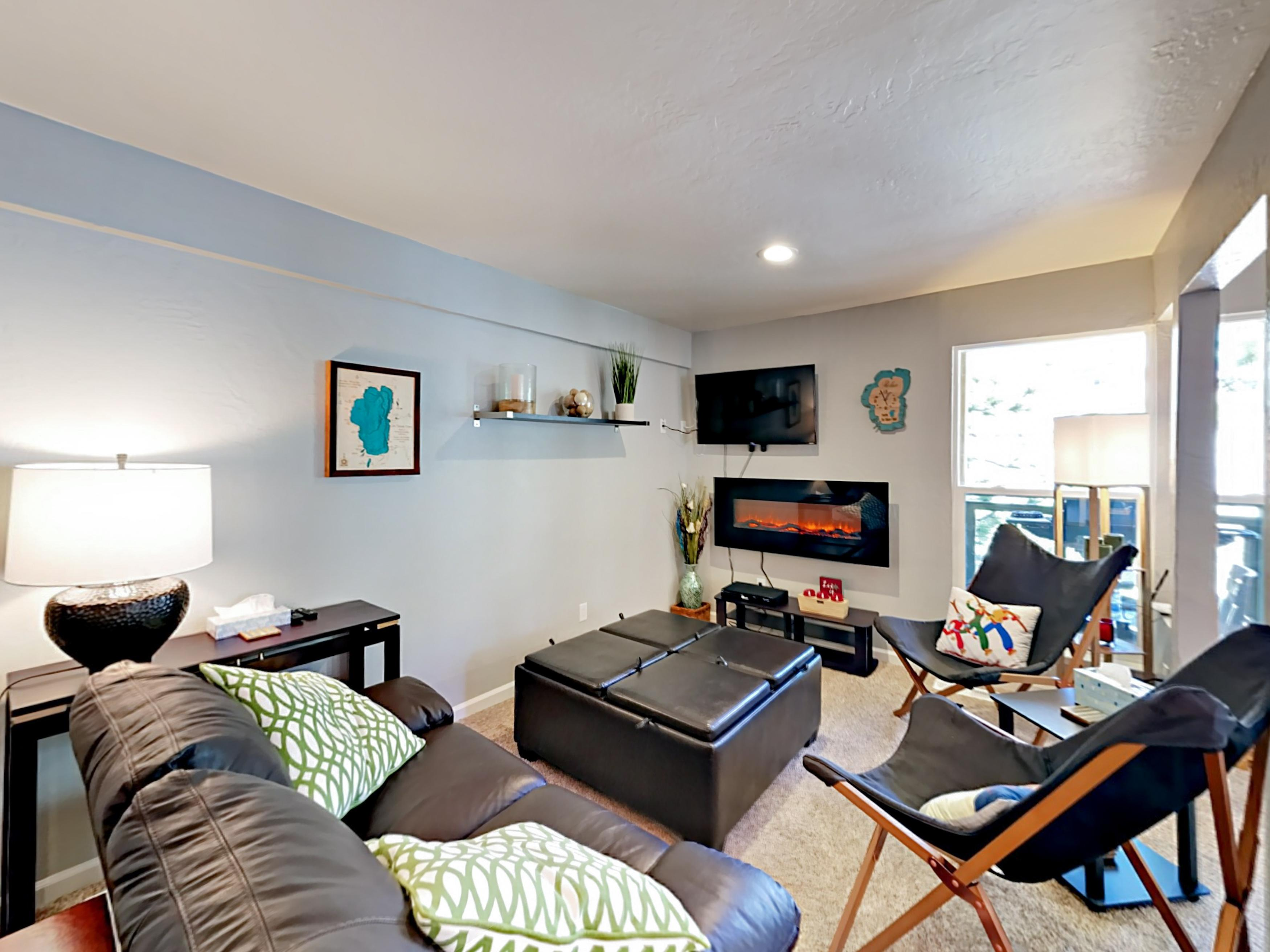 "Welcome to Stateline! Kick back on a sofa and 2 chairs next to the electric fireplace for a movie on the 42"" TV."