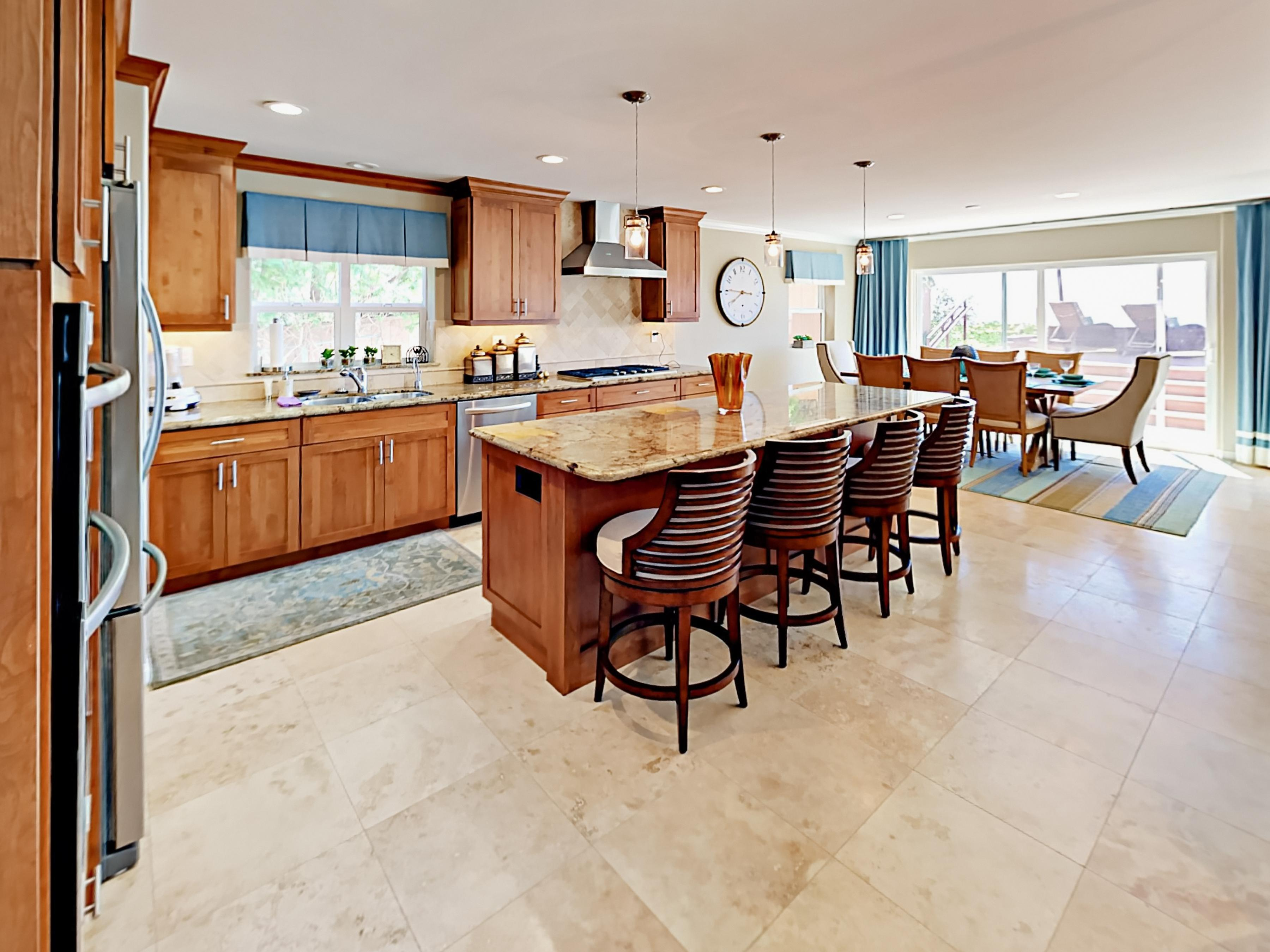The gourmet kitchen features granite countertops, stainless steel appliances, and a pantry.