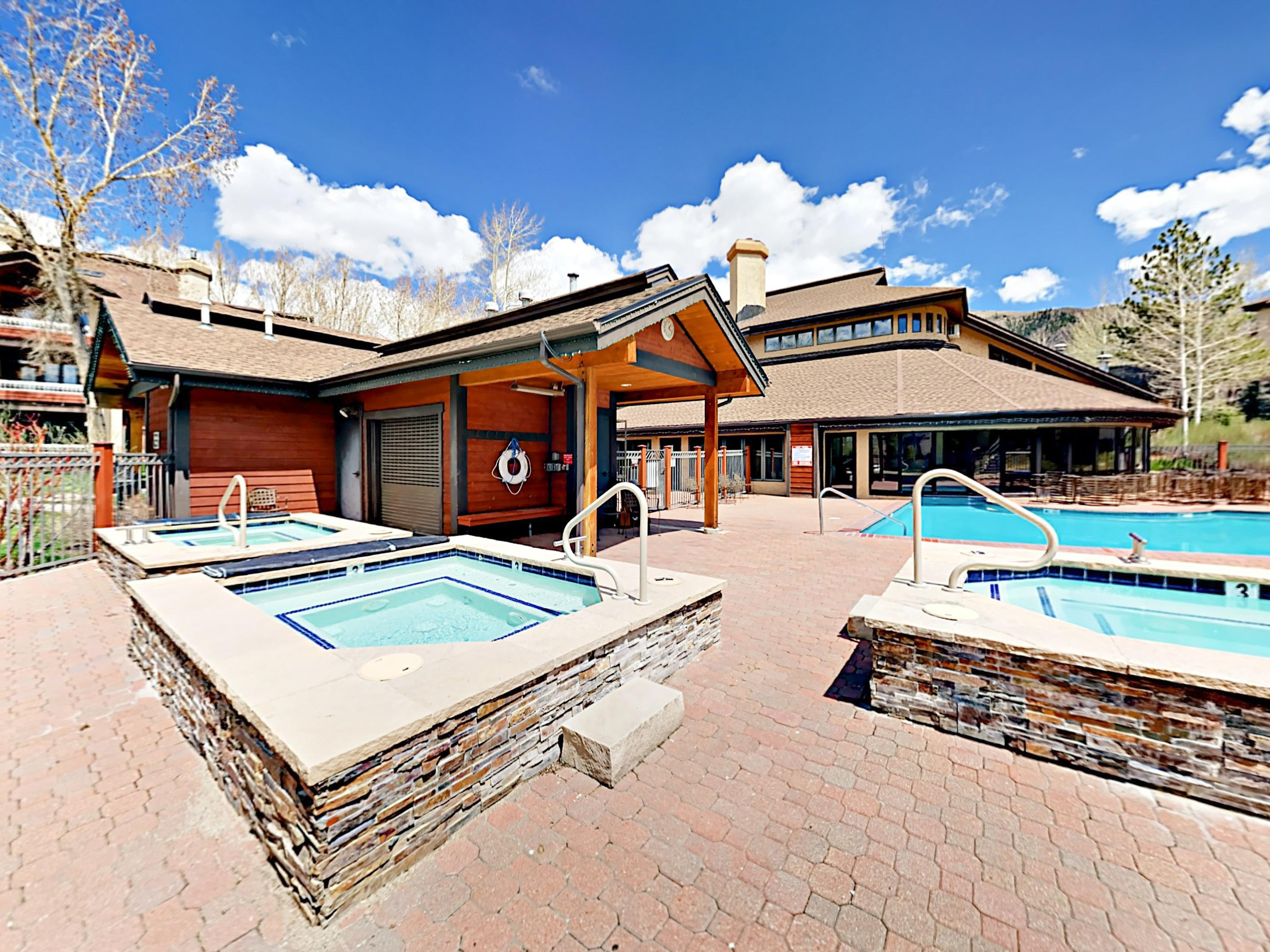 This complex features 10 hot tubs, with 3 right by your unit!
