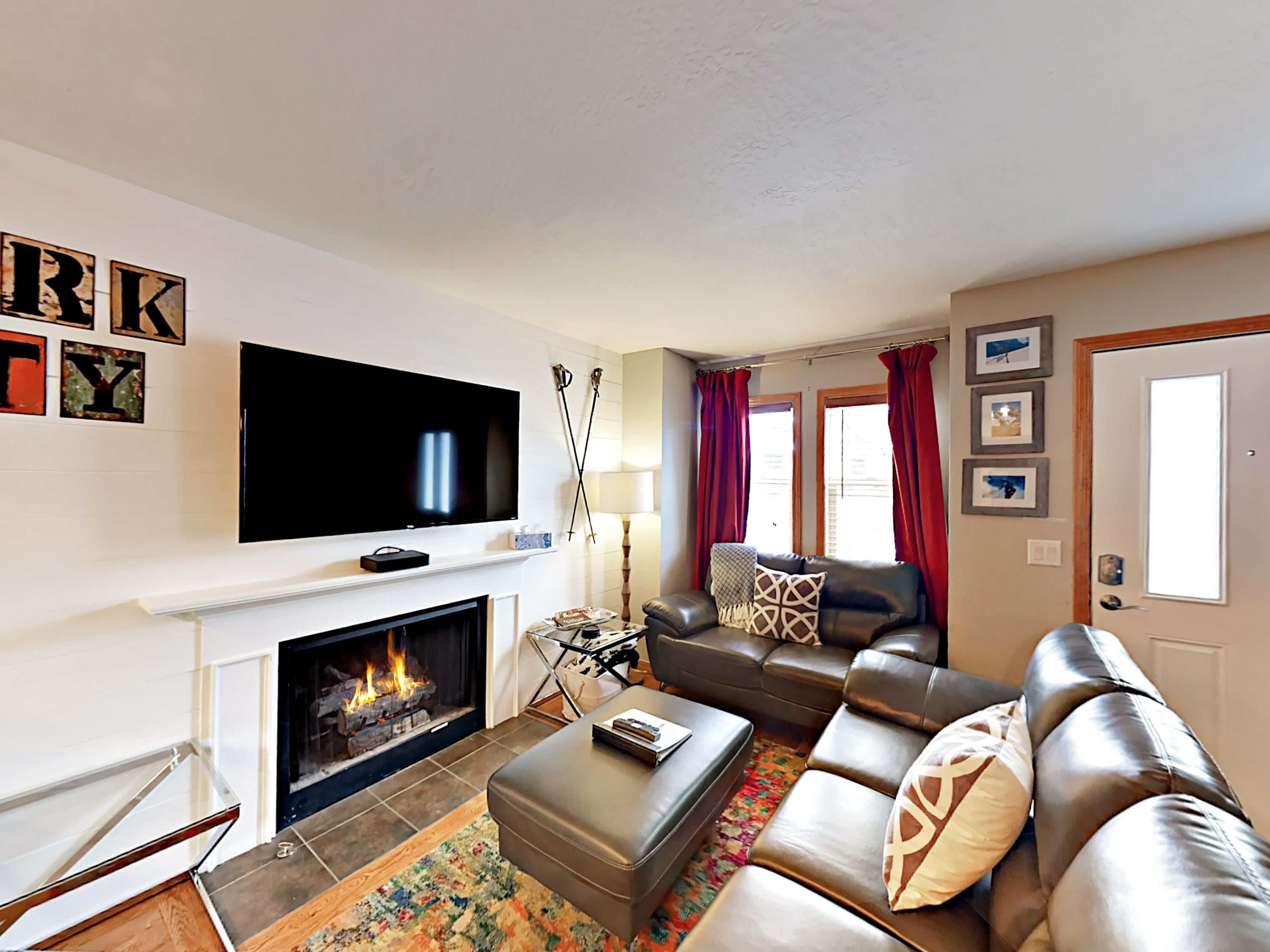 Seating for 5 in the living area, equipped with a flat screen TV and complimentary Wi-Fi.