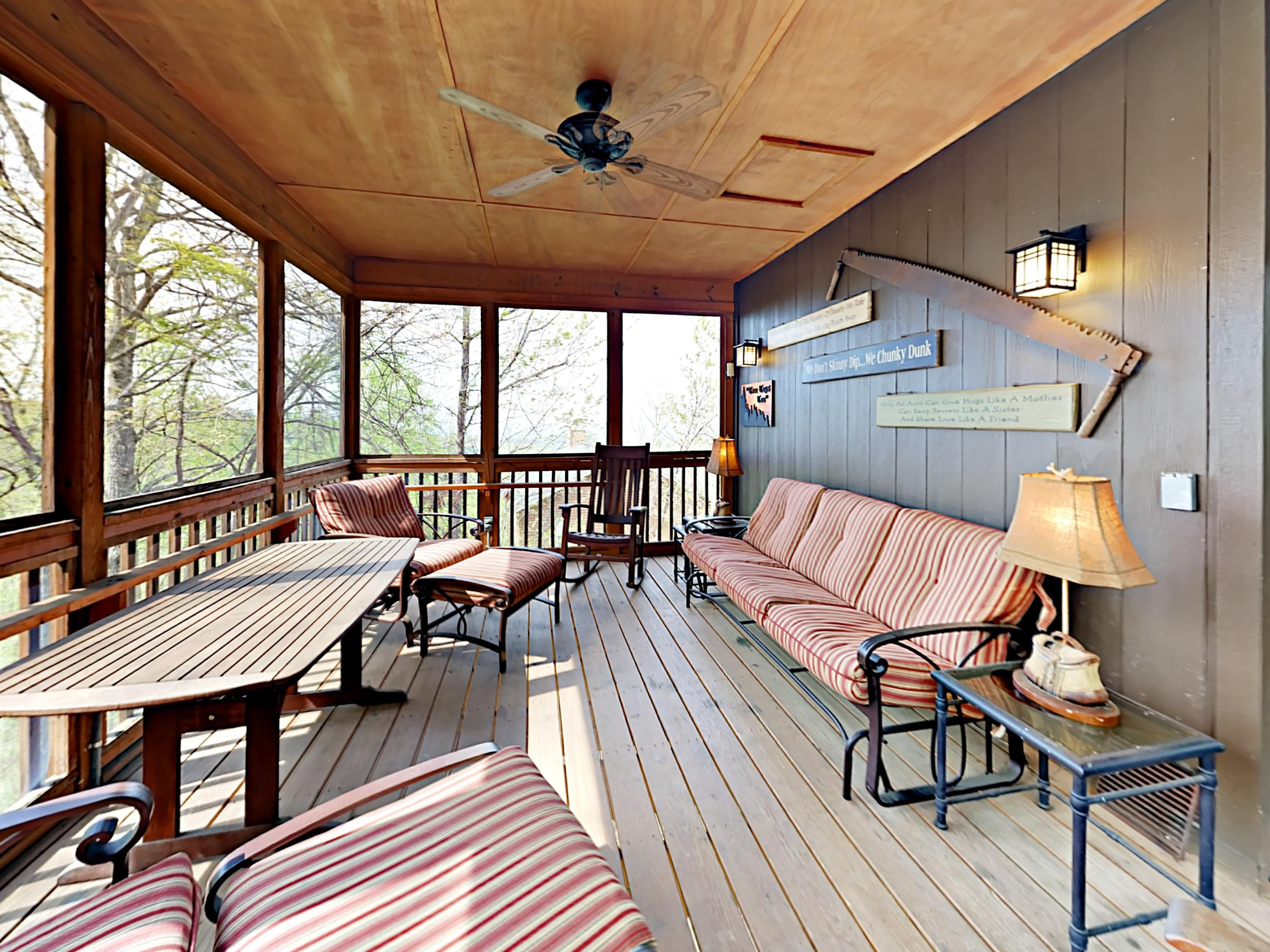 Breathe the fresh mountain air from a sofa and 4 chairs on the screened porch.