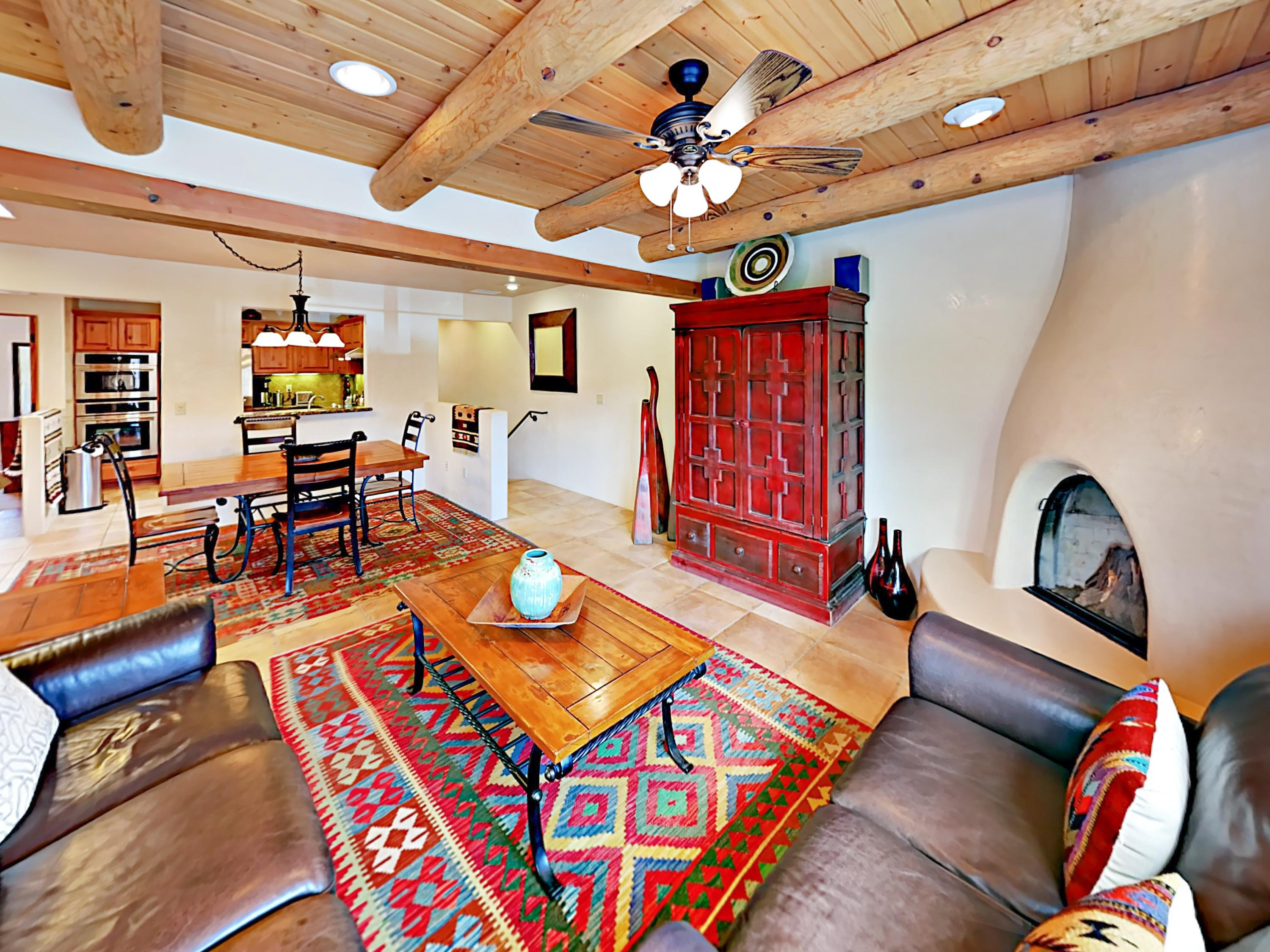 Welcome to Santa Fe! Bright and airy, this luxuriously appointed home offers high-end finishes throughout including vigas and hand-troweled Venetian plaster walls.