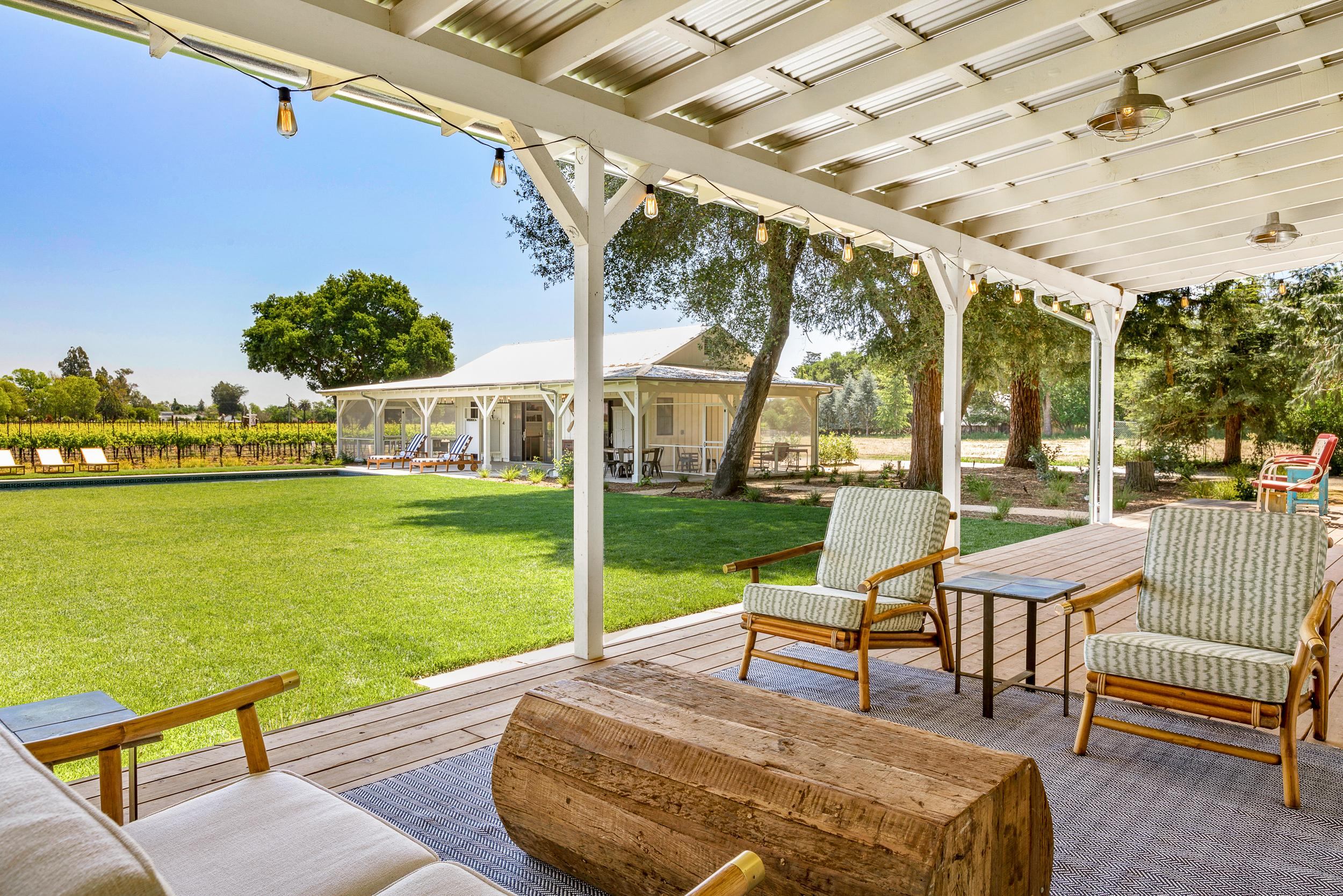 Kick back in the outdoor living area with cozy seating and rugs.