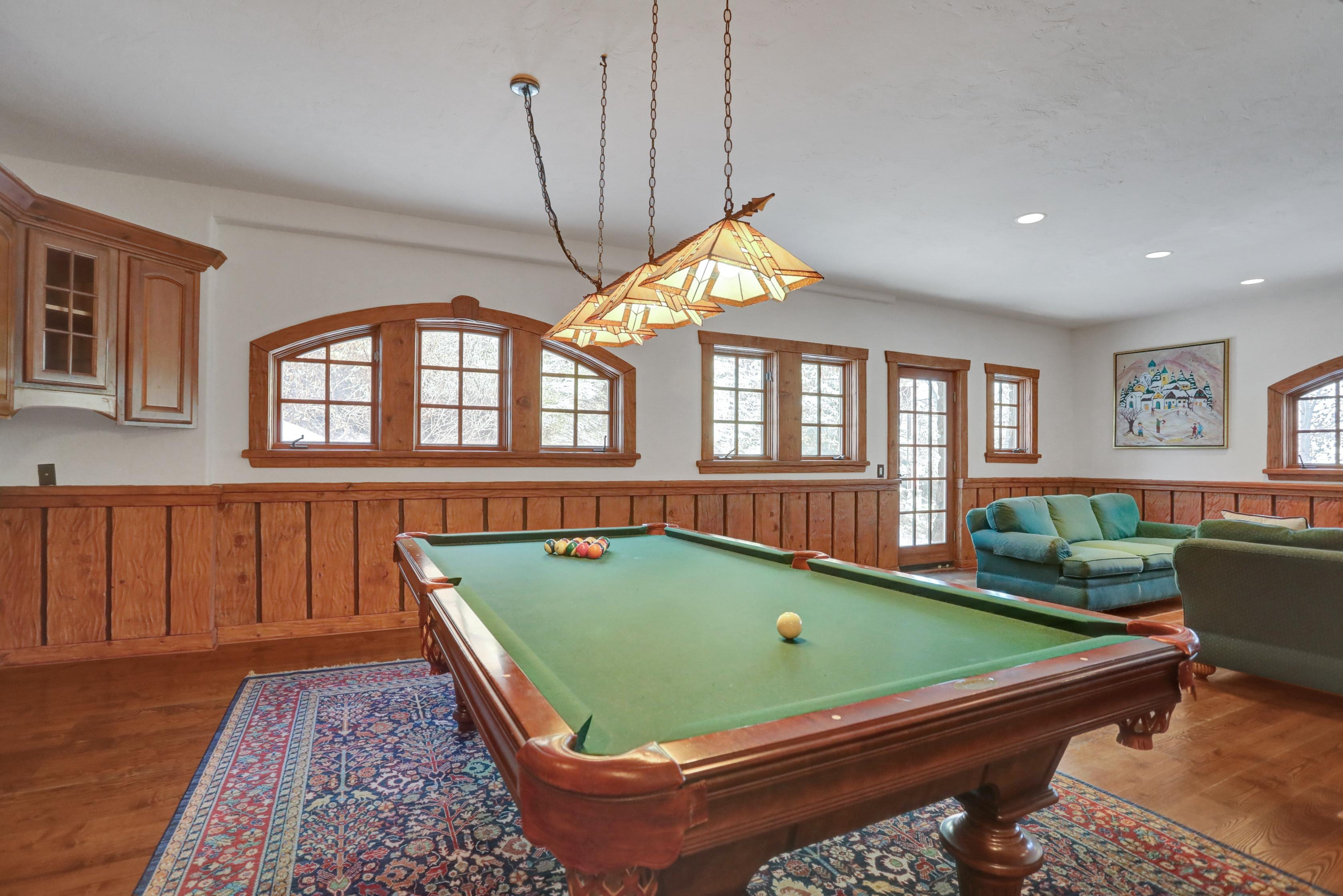 Rack up the pool table in the game room.