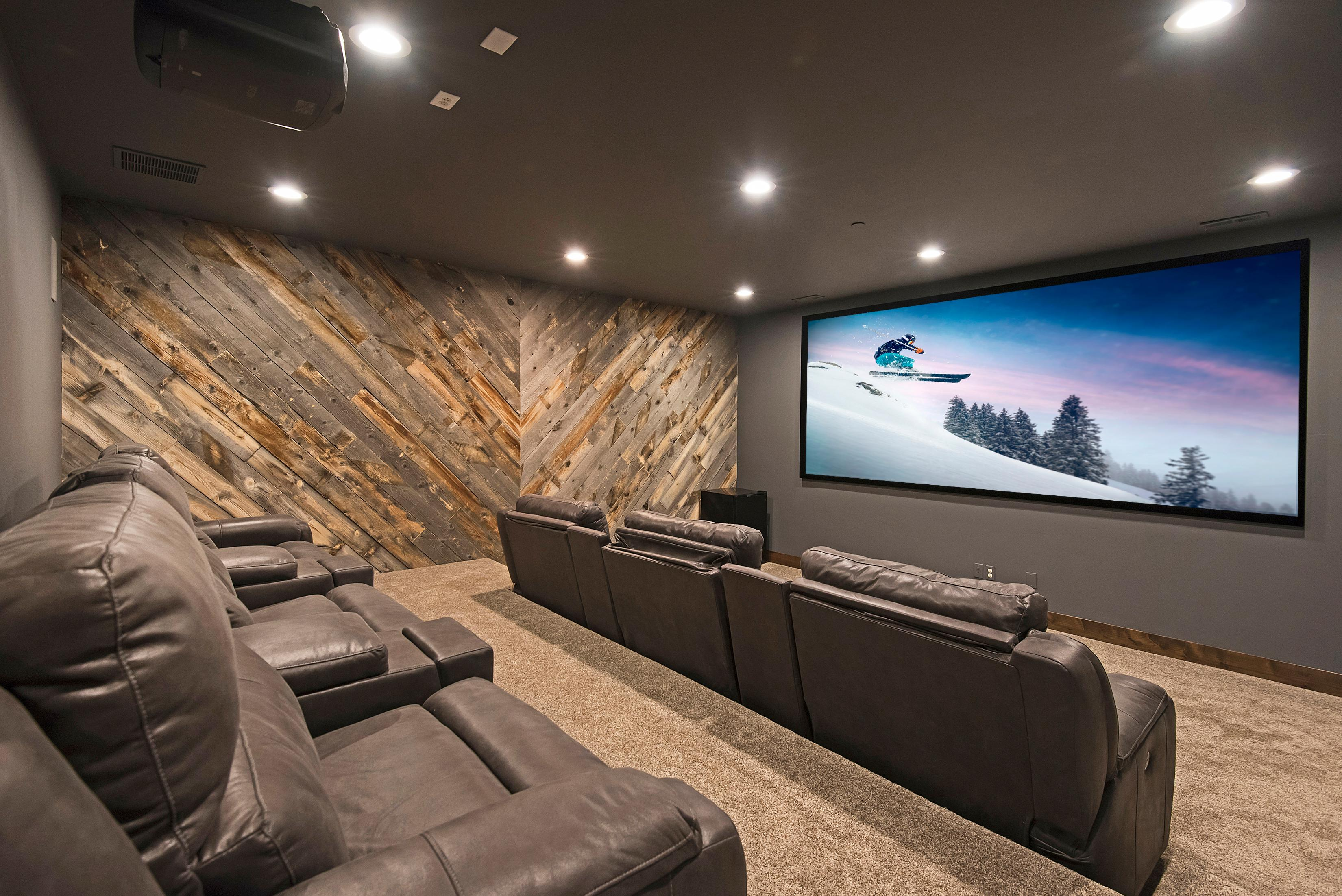 "Your rental includes a home theater with staggered cinema seating and a huge 150"" projector screen."