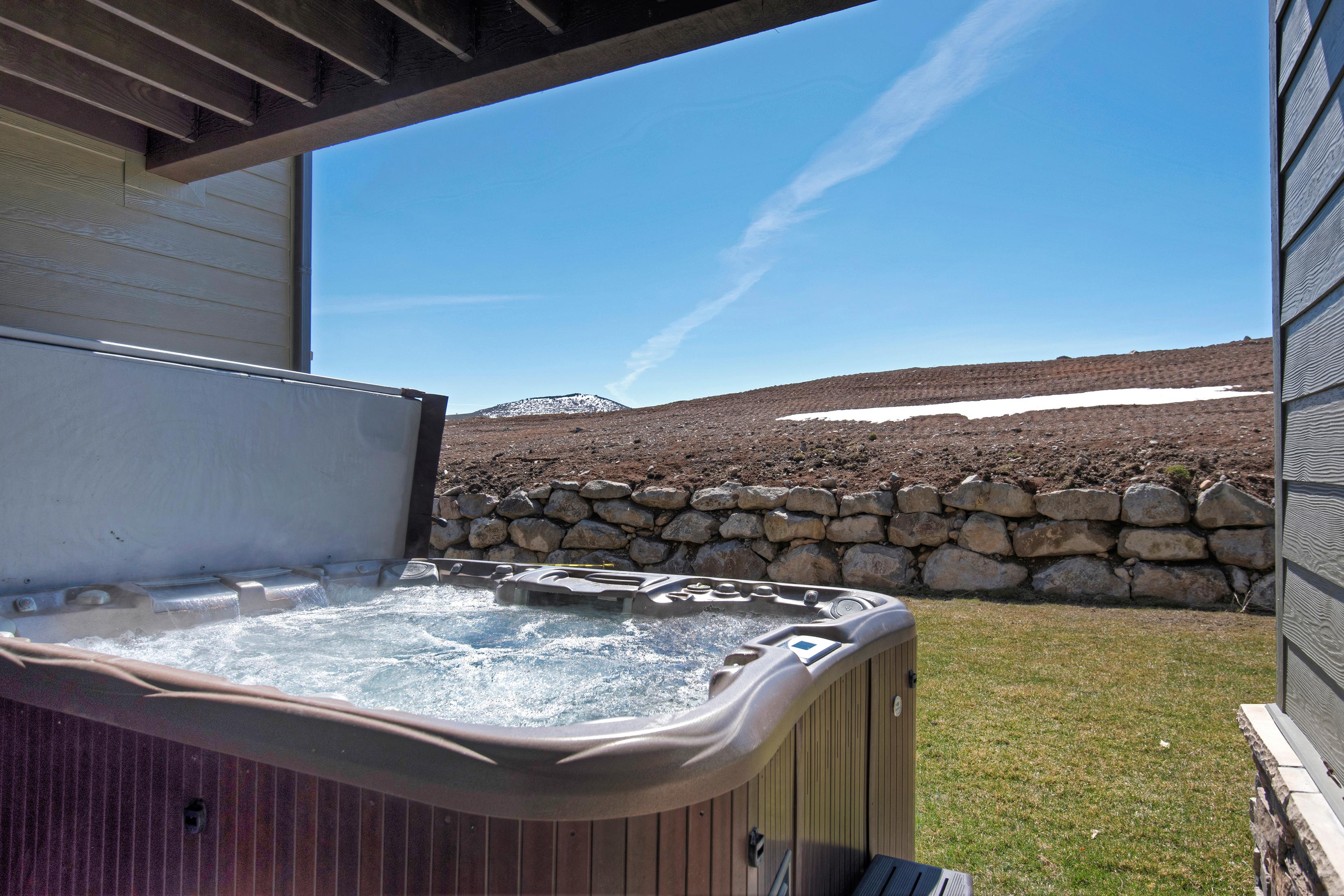A private 8-person hot tub beckons after a fun-filled day of alpine adventures.