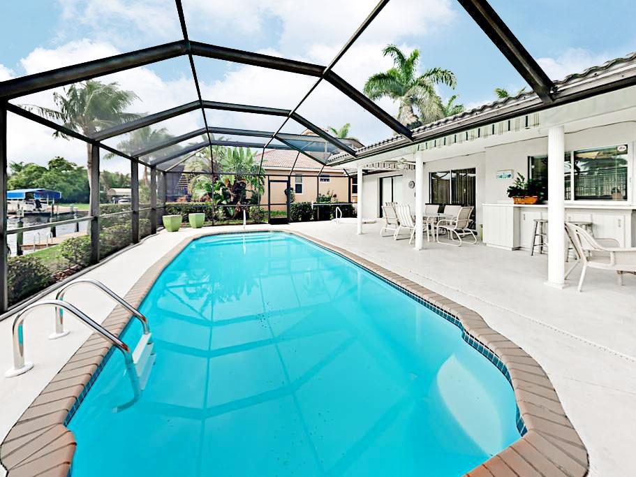 Welcome to Cape Coral! Relax around the screened pool at this home, professionally managed and maintained by TurnKey Vacation Rentals.