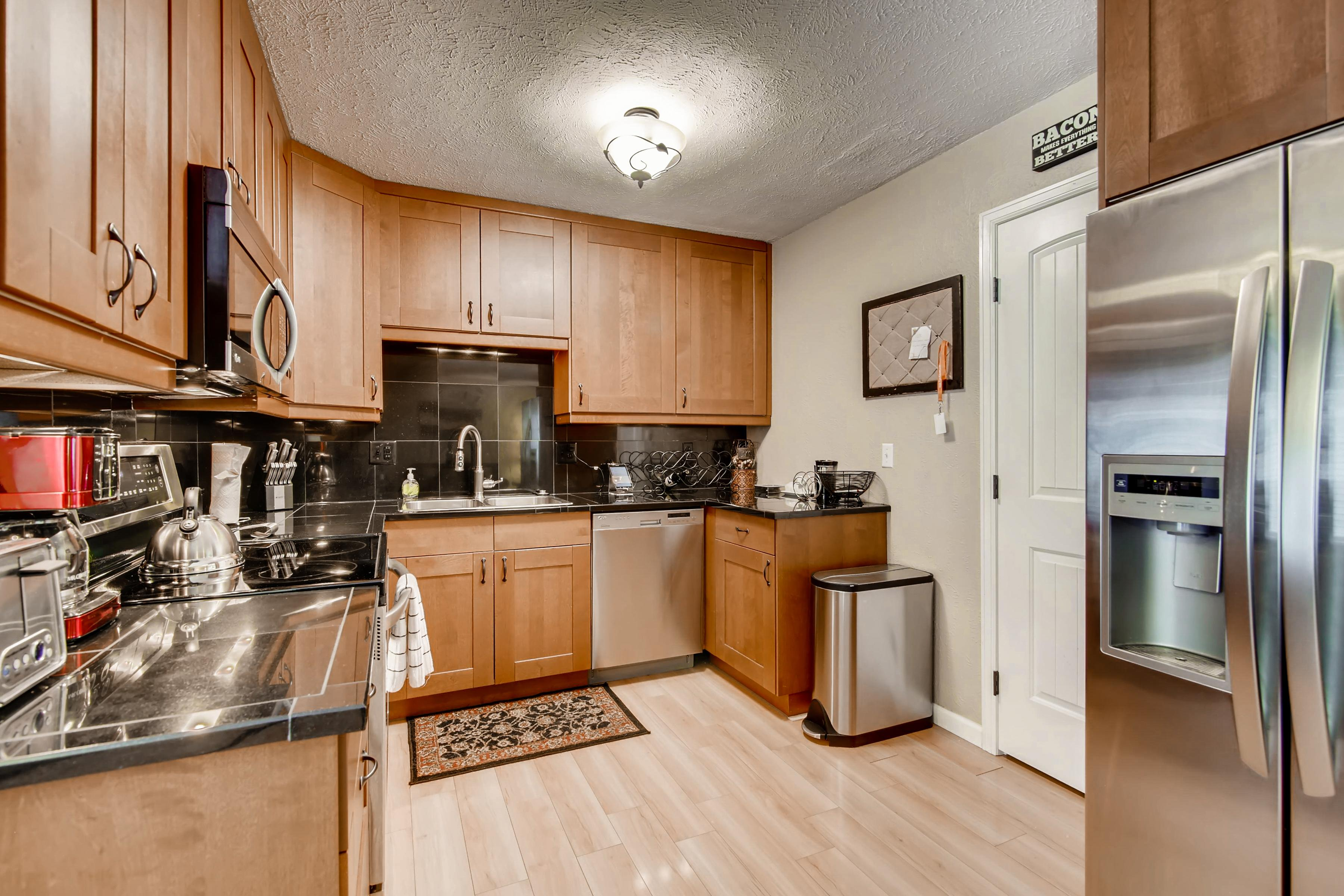 The chef in your group will appreciate the gourmet kitchen with stylish wooden cabinetry and stainless steel appliances.