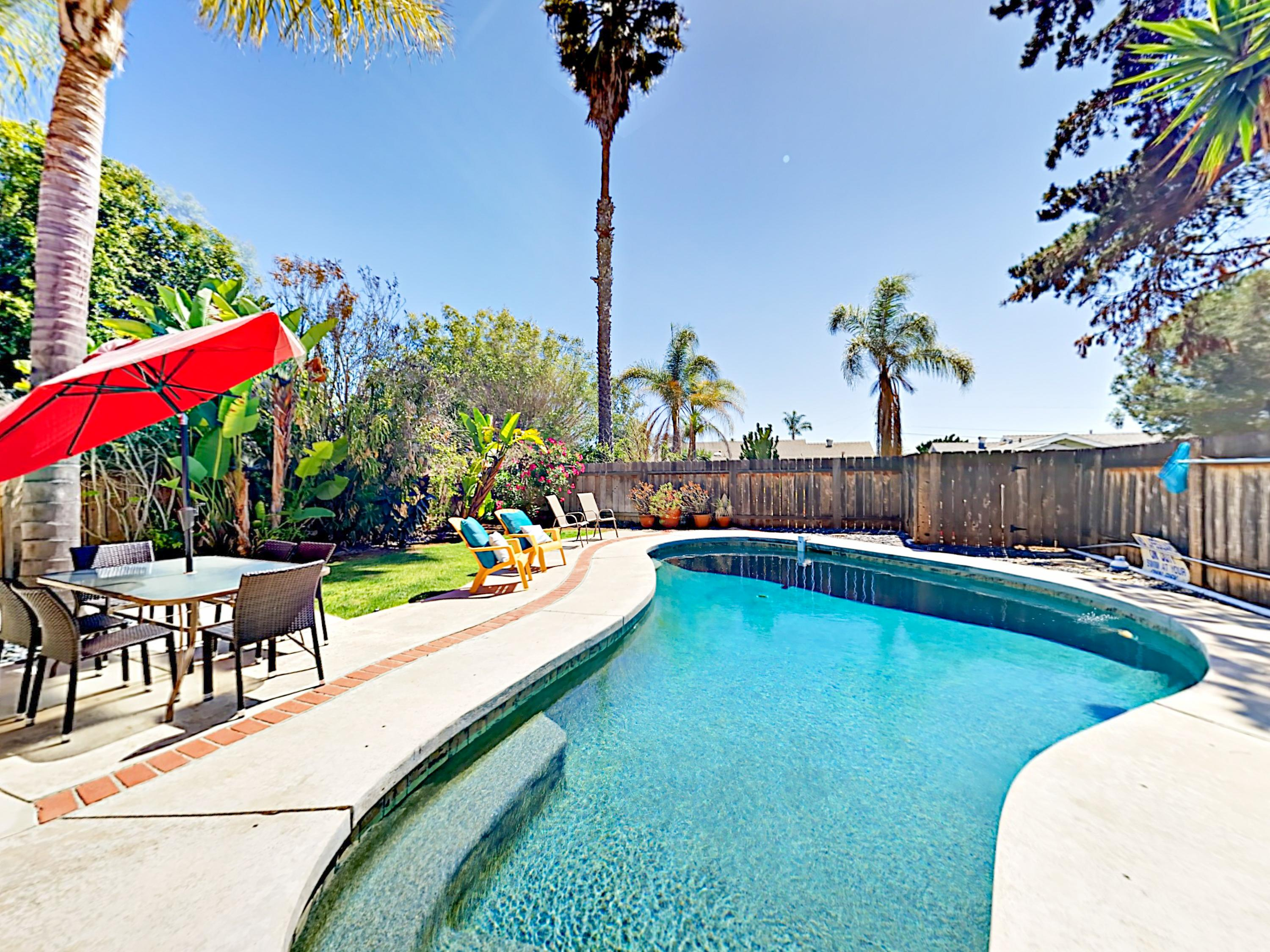 Relax around the backyard pool at this inviting San Diego home, professionally managed by TurnKey Vacation Rentals.