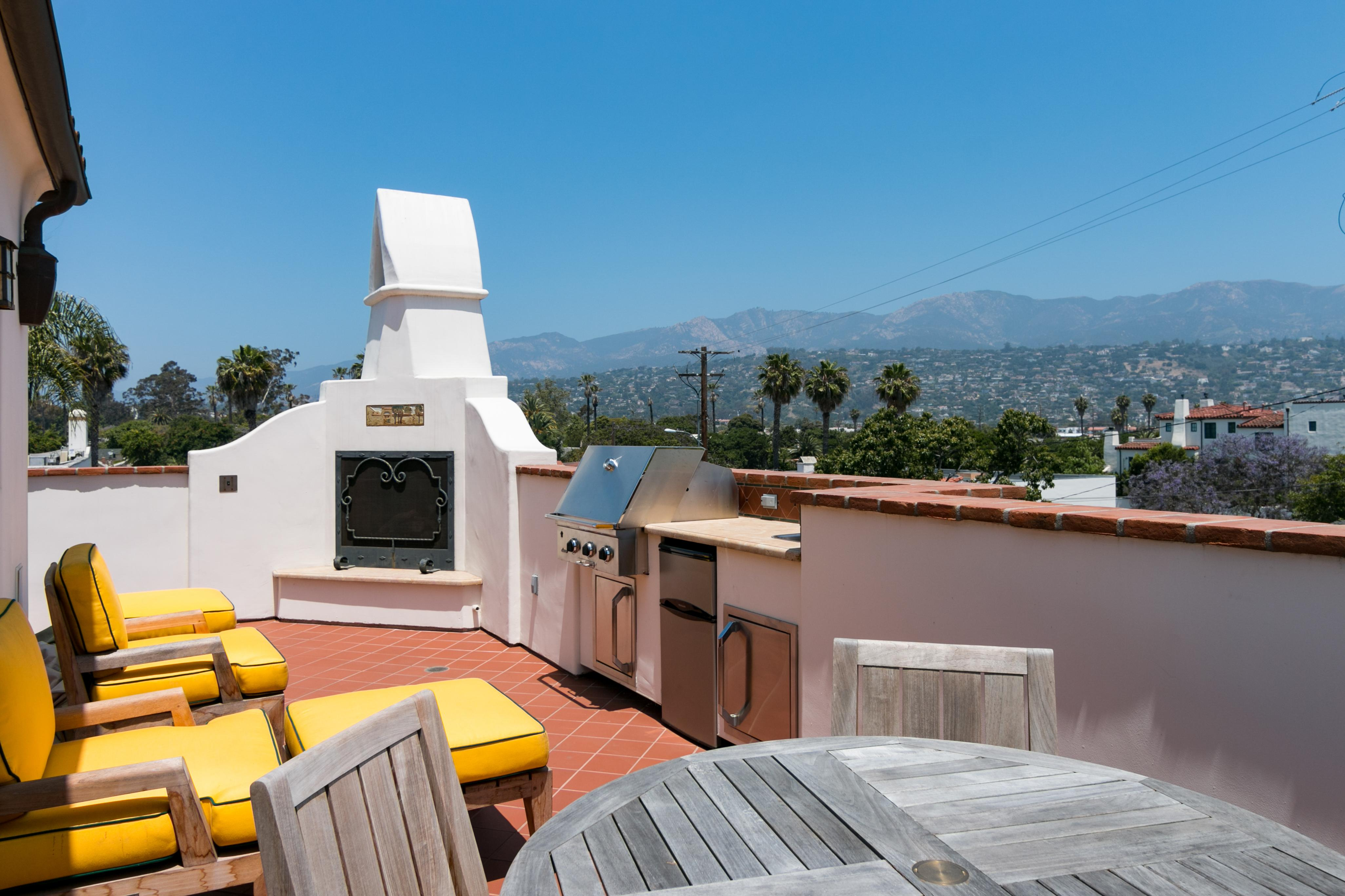 Fire up the grill on the upper floor balcony and enjoy an alfresco feast.