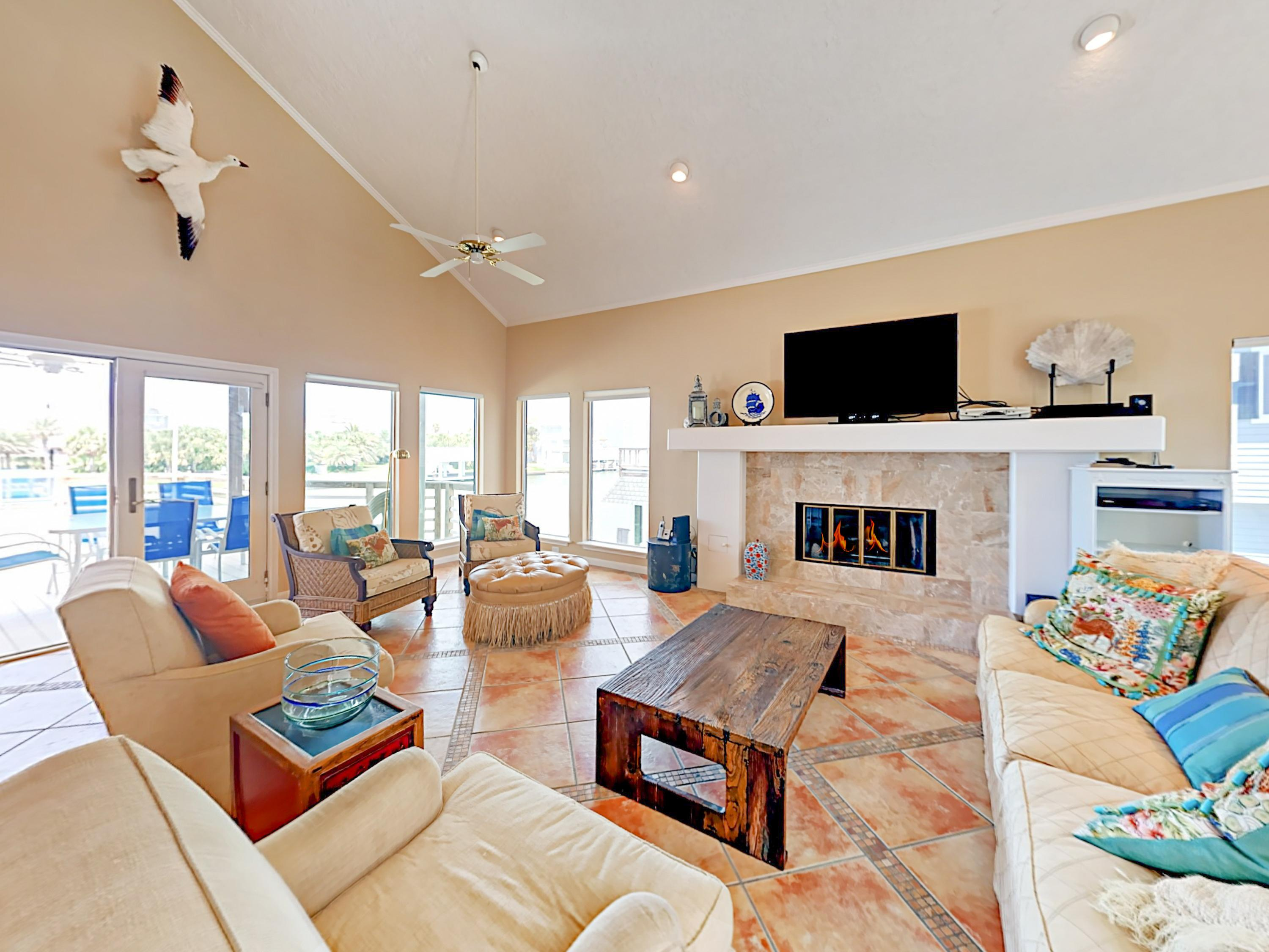 "Sprawl out in the living room with a sofa, 4 chairs, 55"" TV, gas fireplace, and vaulted ceilings."