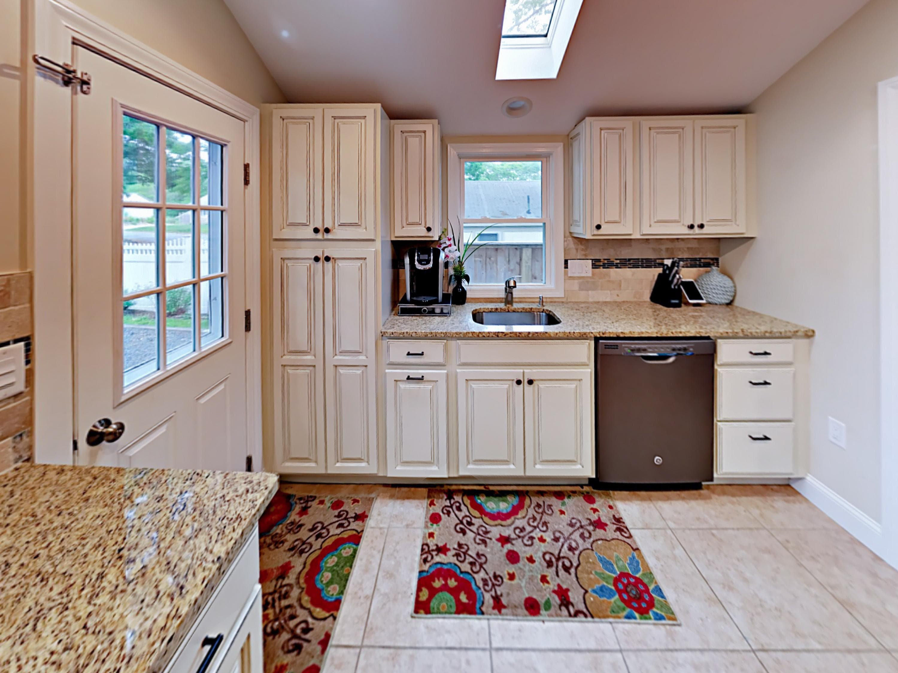 Granite countertops and quality stainless steel appliances shine in the gourmet kitchen.