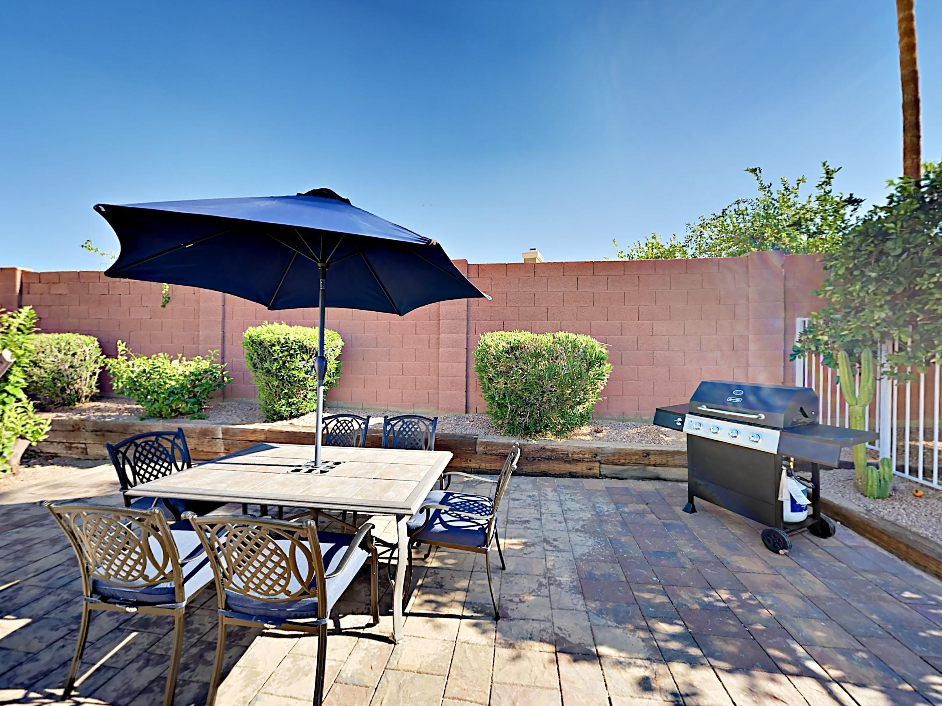 Host a family cookout on the patio, surrounded by a privacy wall.