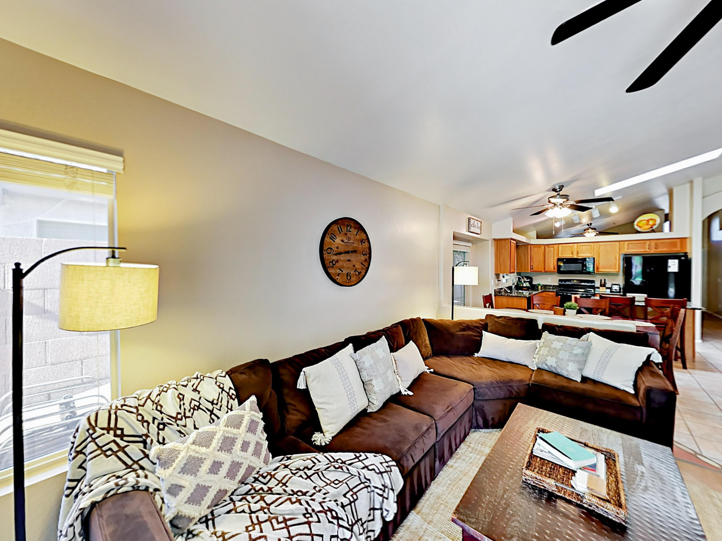A plush sectional sofa offers comfy seating in the main living area.