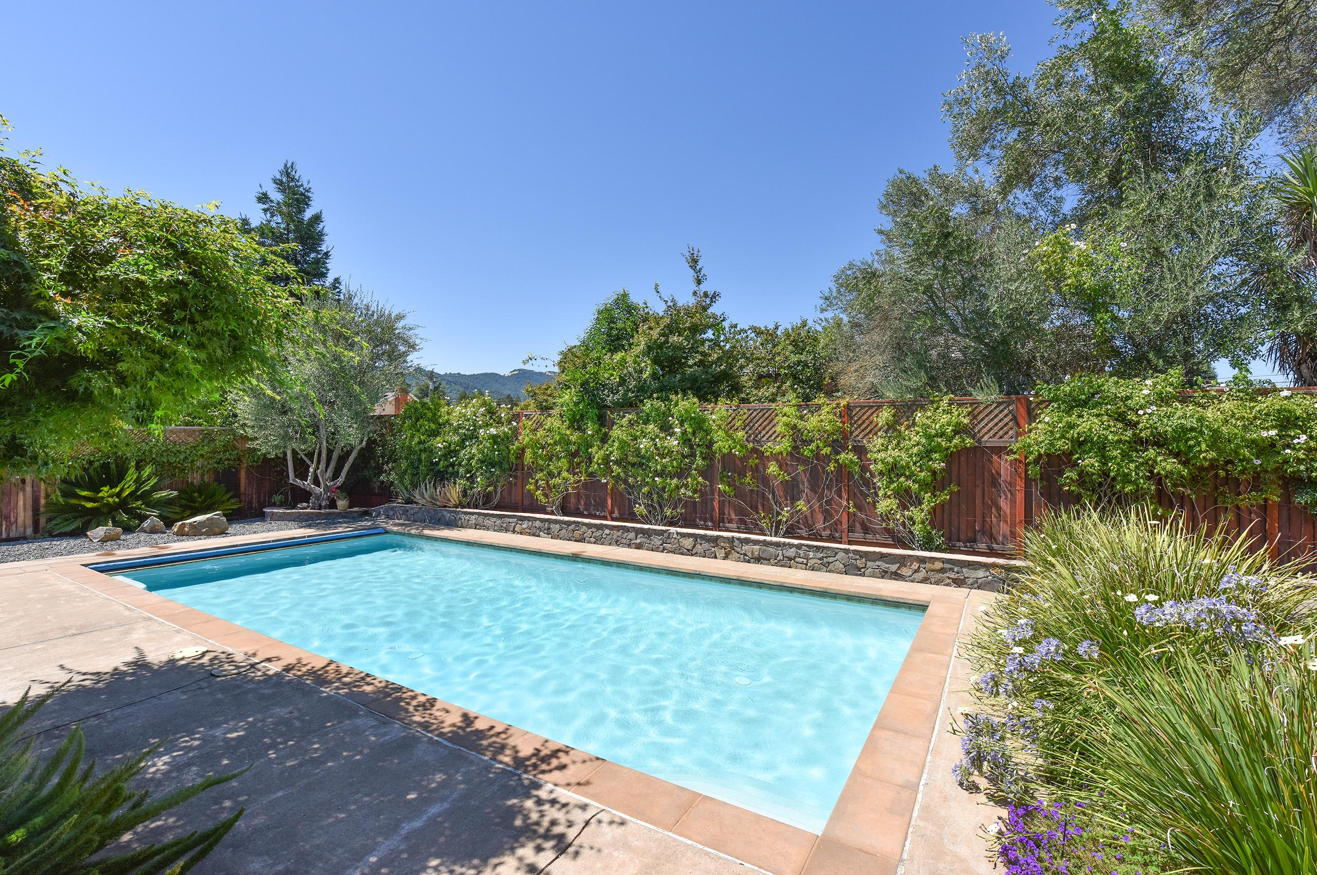 Welcome to gorgeous Sonoma! Sparkling pool for a refreshing afternoon dip, surrounded by lush landscaping and a view of the rolling California hillsides.