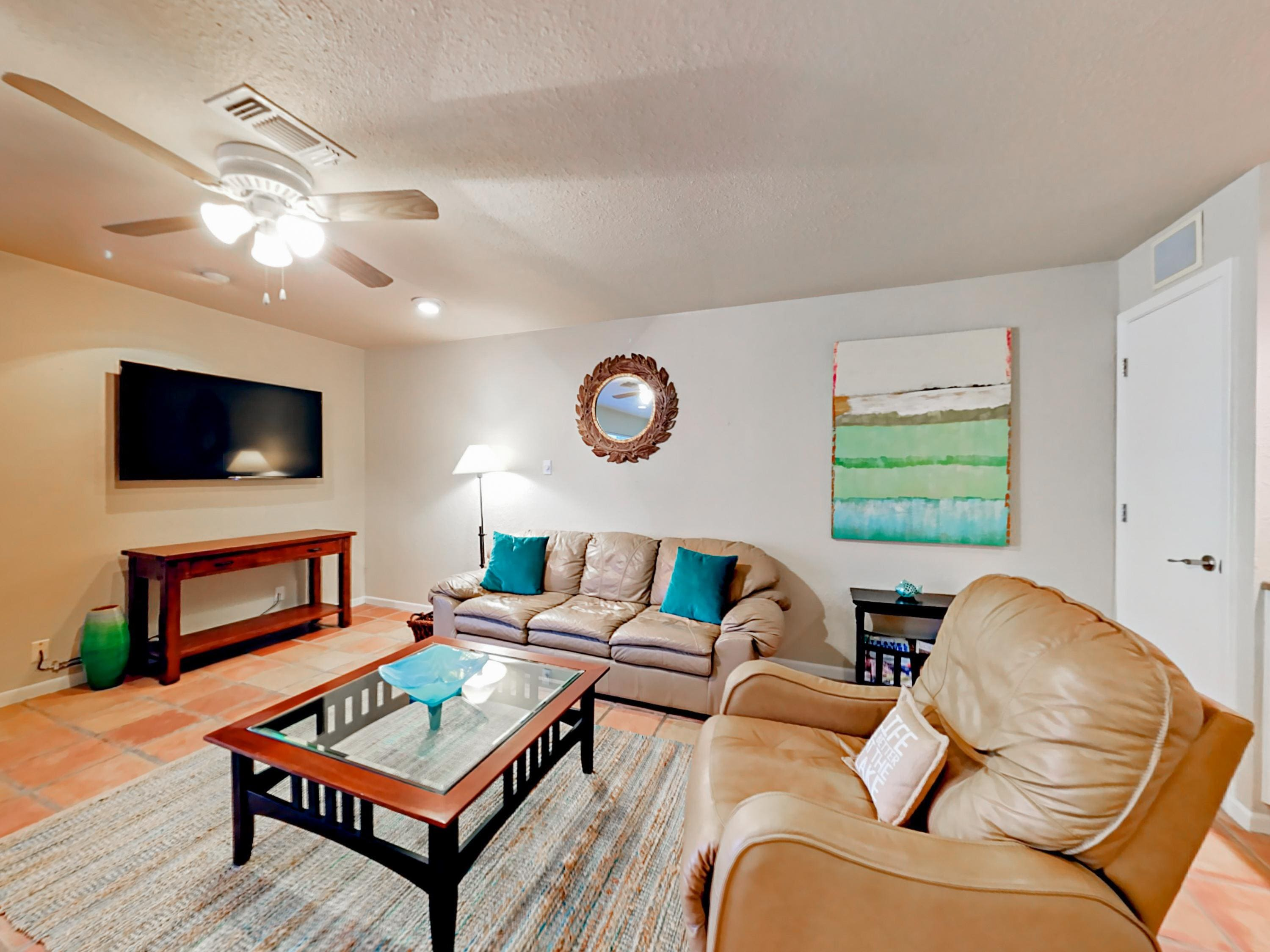 Spend time together in the open living area with a leather sofa, matching recliner, and flat screen TV. Complimentary Wi-Fi provided.
