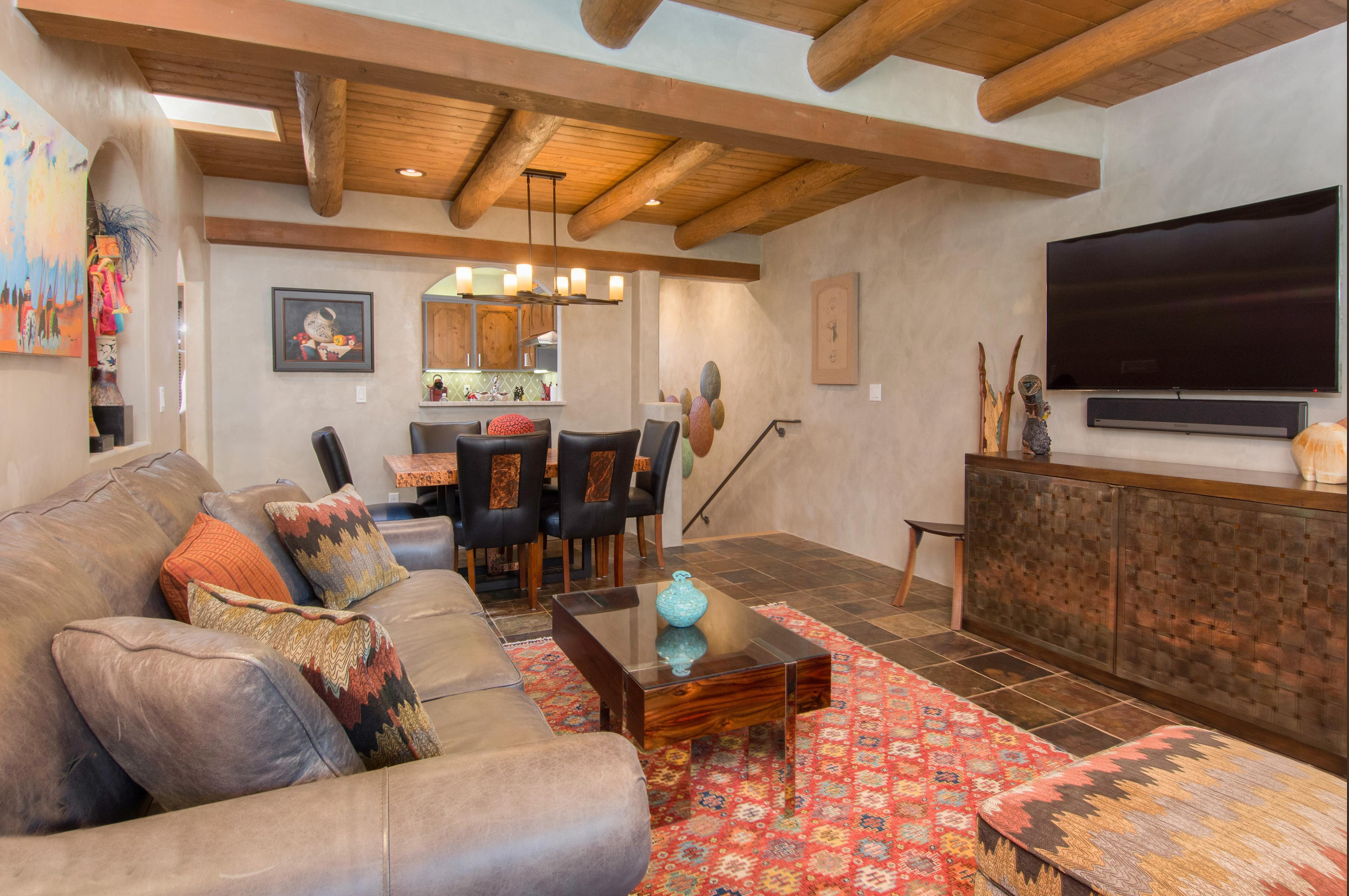 Pueblo-style interior detail including vigas ceilings and a kiva fireplace pair beautifully with southwestern decor.