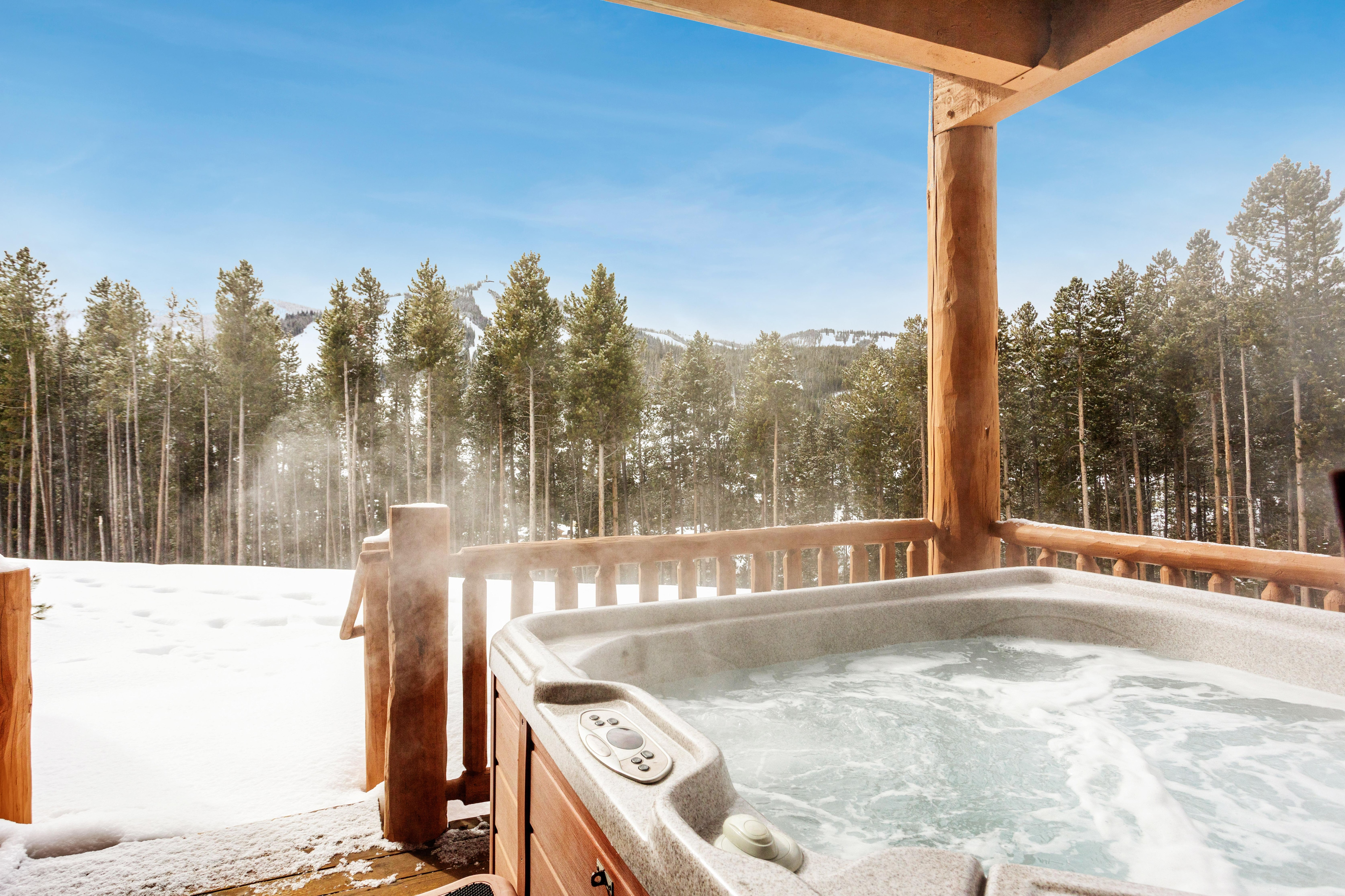 Take luxurious soaks in your private hot tub with mountain views.