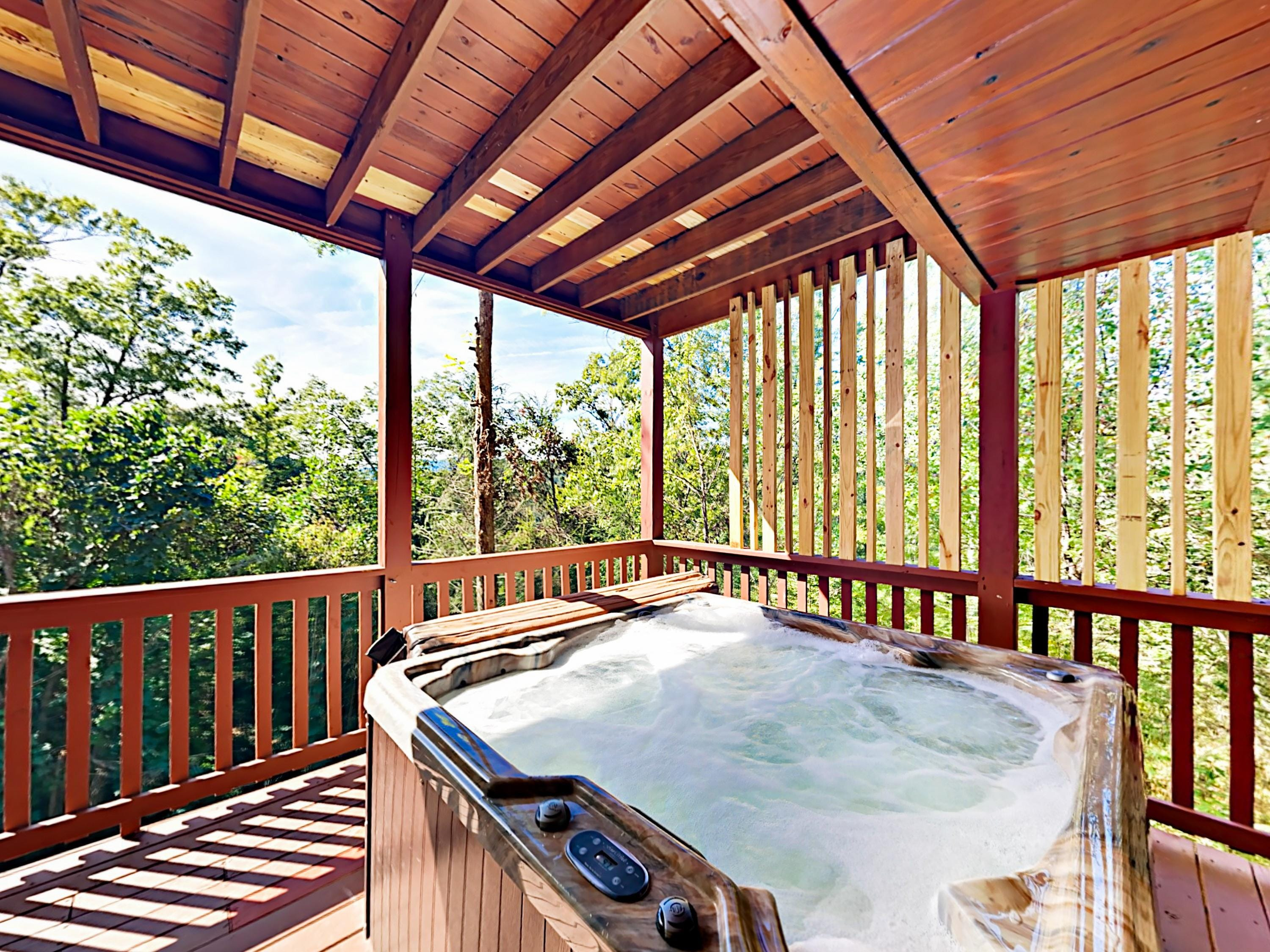 A bubbling hot tub awaits on the covered deck.
