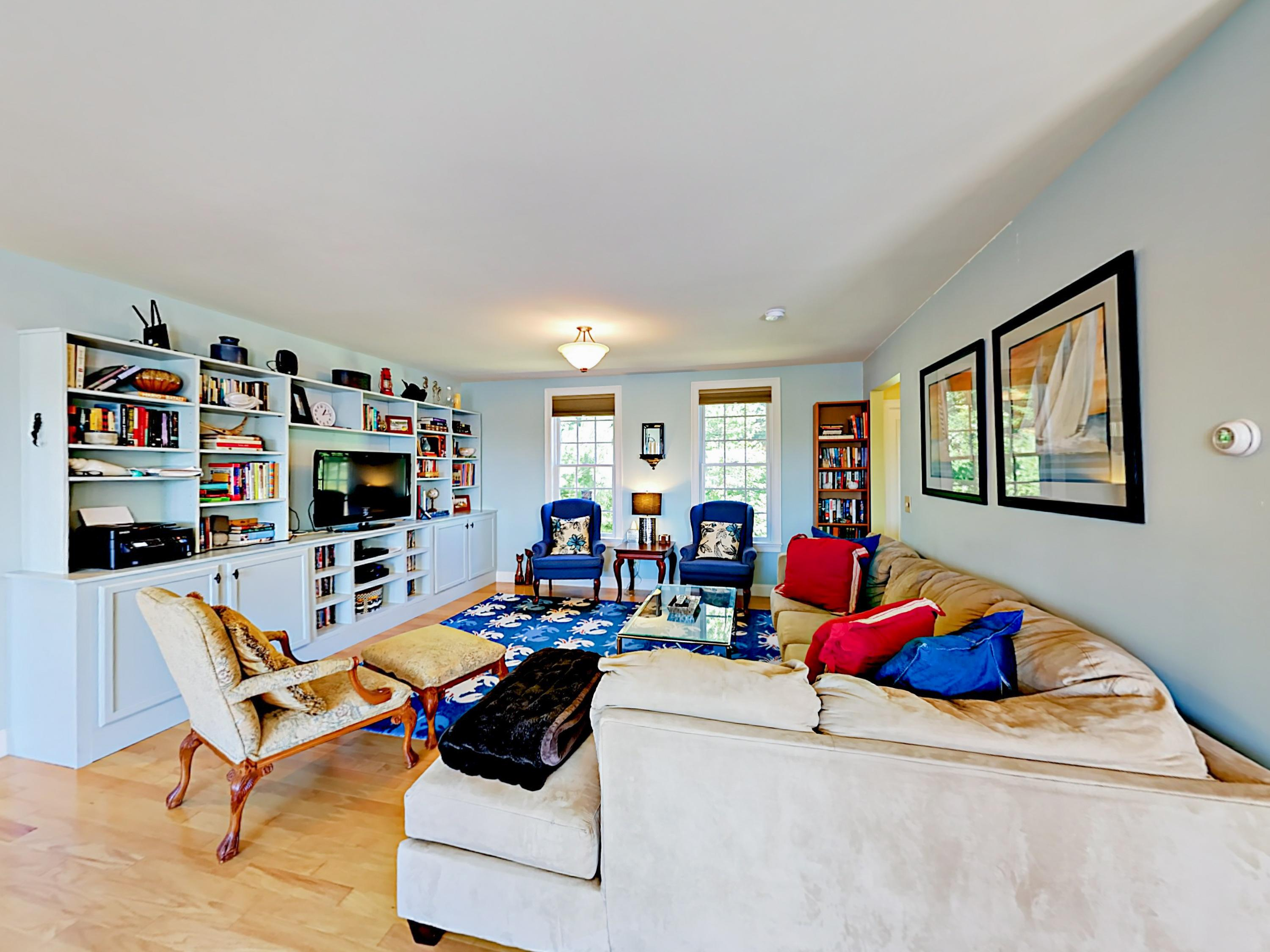 A sectional sofa and sitting chairs furnish the main sitting area. Professionally managed by TurnKey Vacation Rentals.