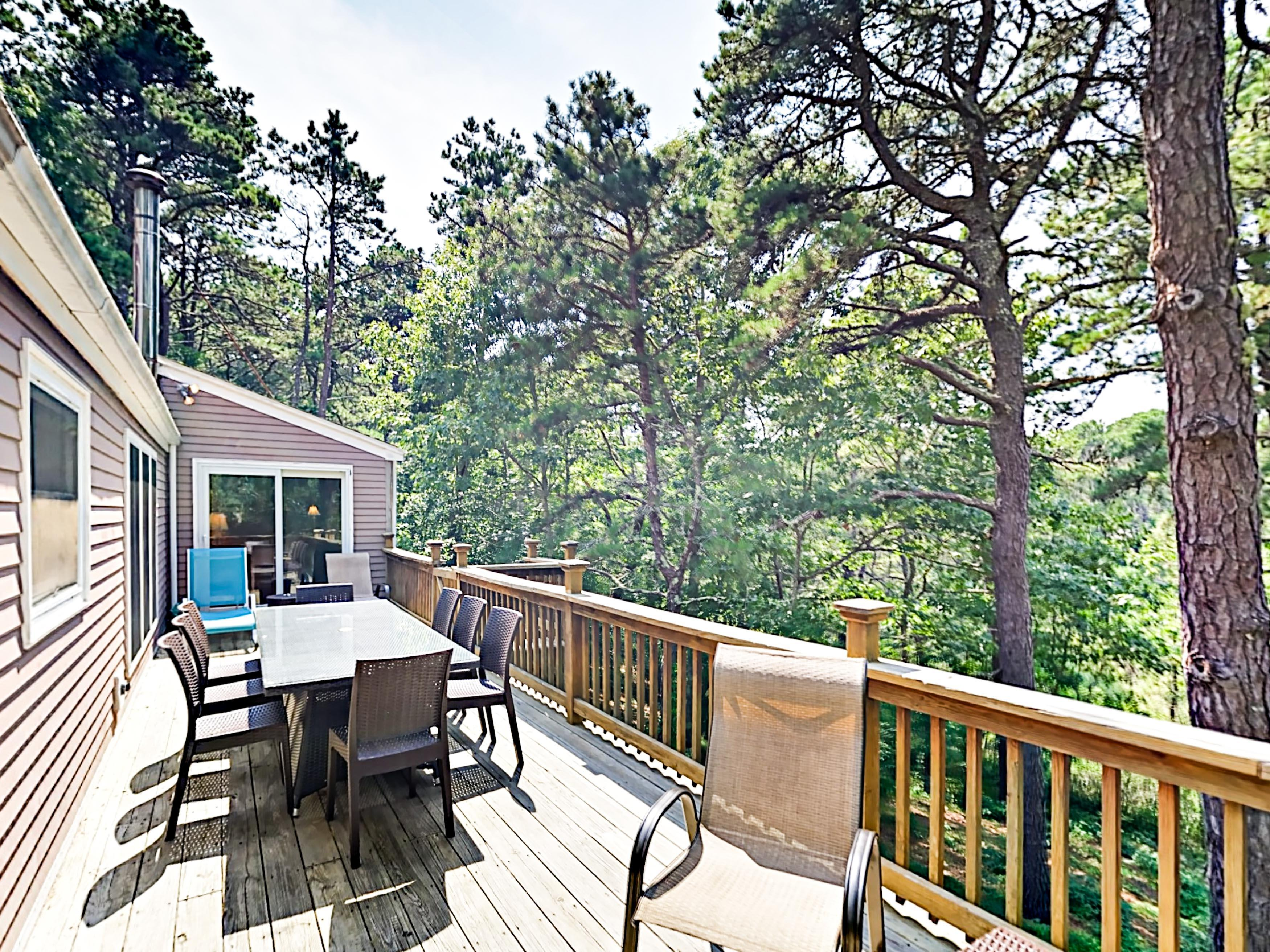 The 50' wraparound deck overlooks the wooded 3-acre property.