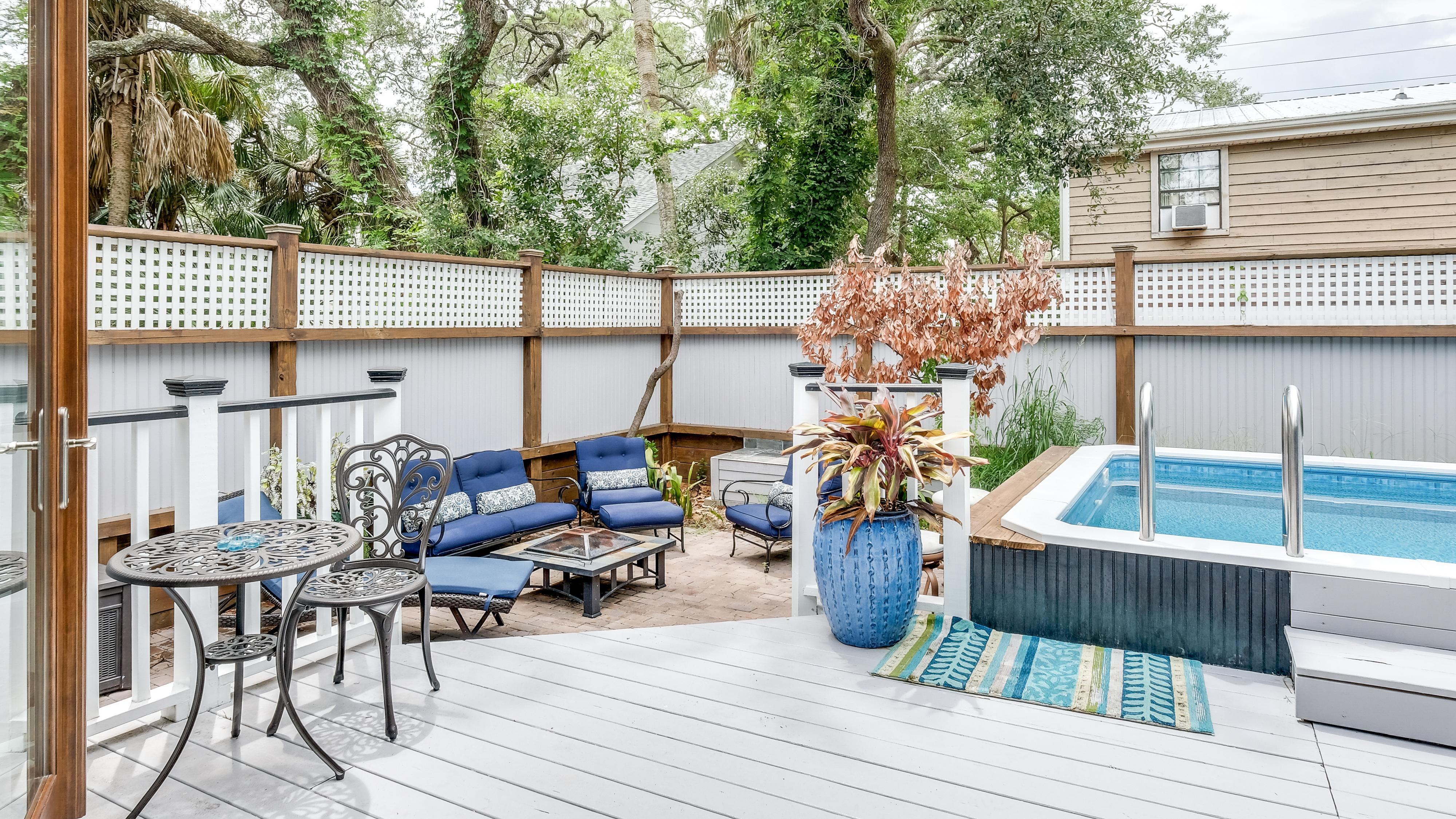 Back patio with pool, fire pit, and seating.