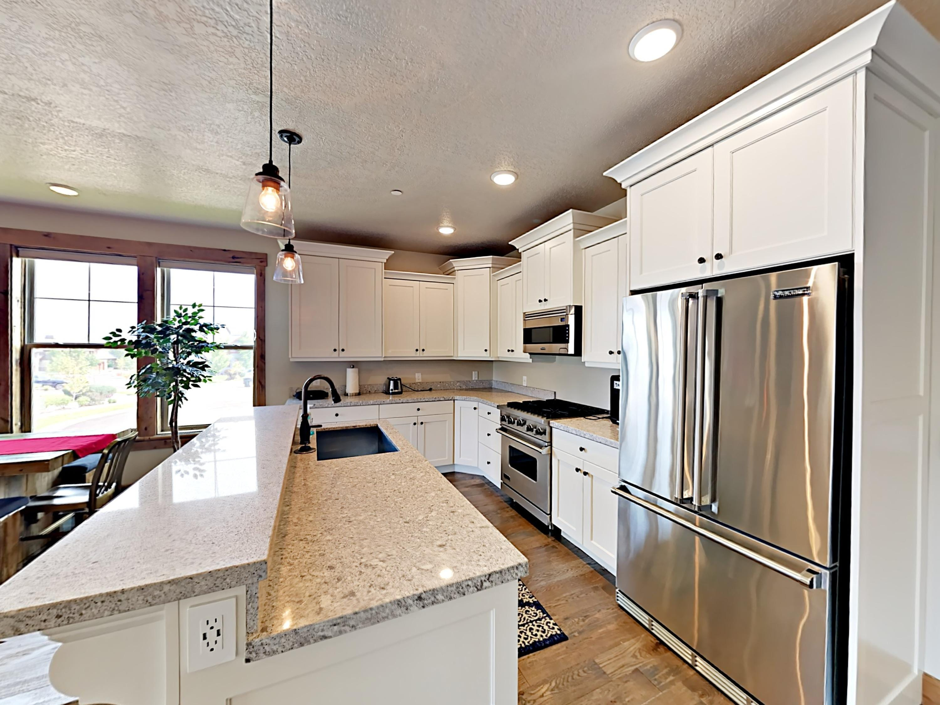 A gorgeous gourmet kitchen includes a starter supply of kitchen amenities (dish soap, paper towels).