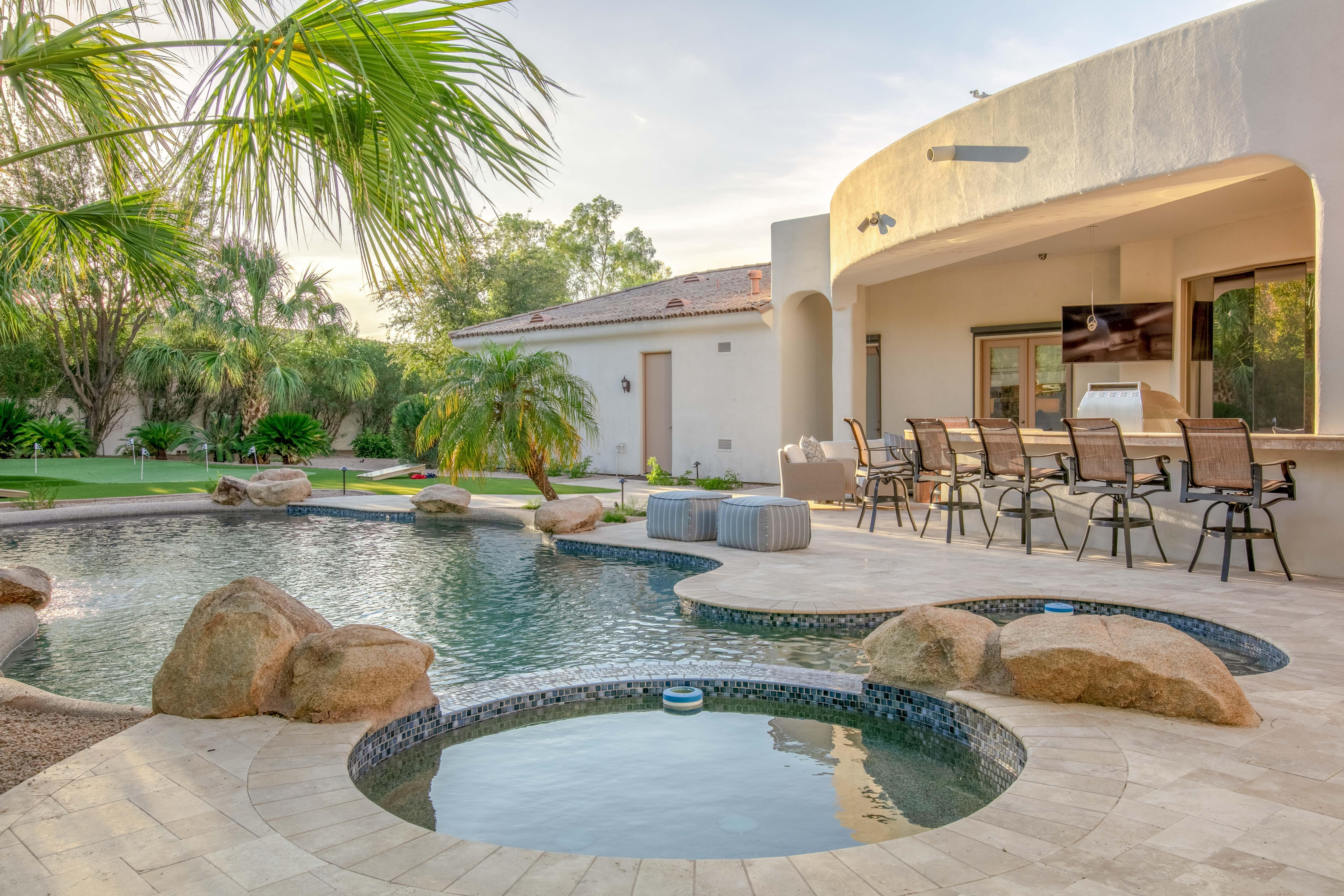 Your outdoor oasis features a pool and hot tub. This Paradise Valley Estate is professionally managed and maintained by TurnKey Vacation Rentals.