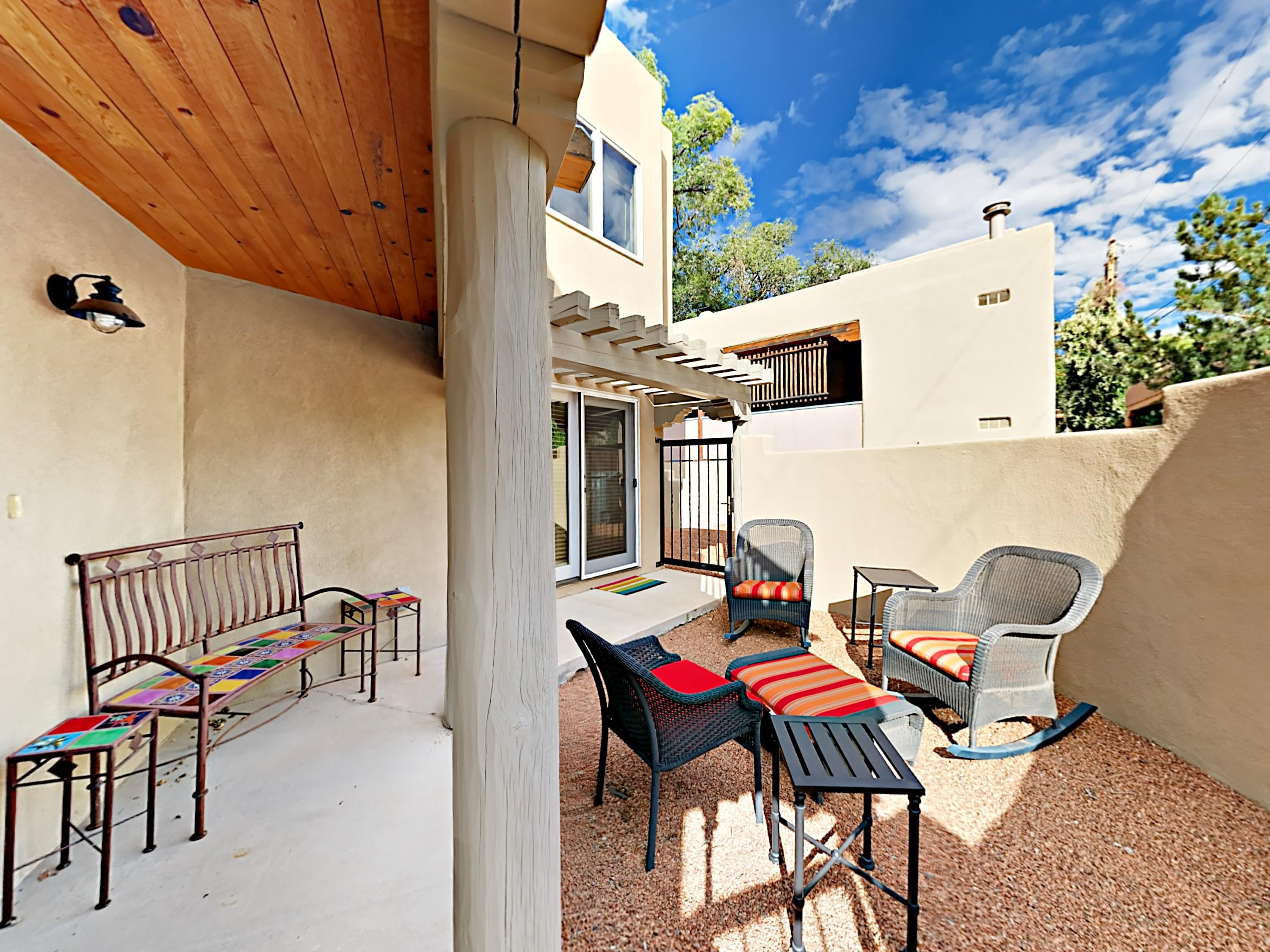 Enjoy sunny outdoor lounge space at this Santa Fe home, professionally managed and maintained by TurnKey Vacation Rentals.
