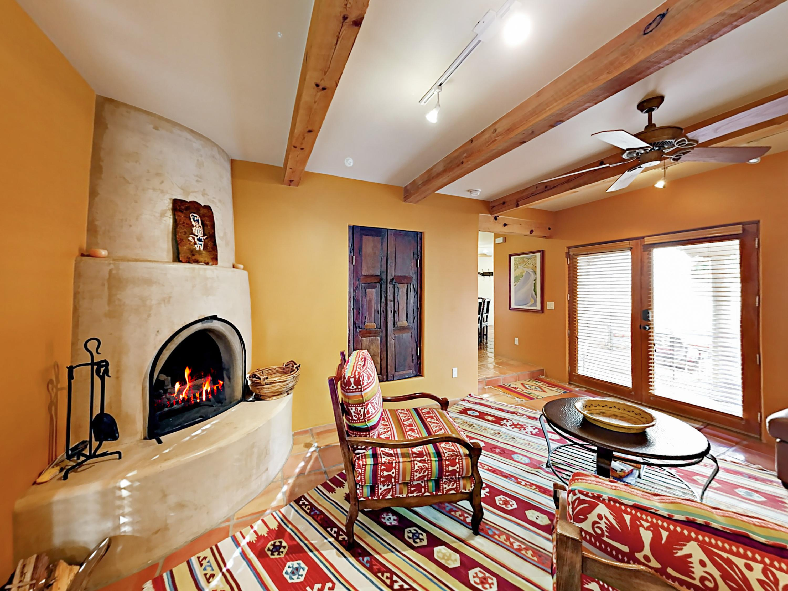 Southwestern-style living area with cozy seating and kiva fireplace.