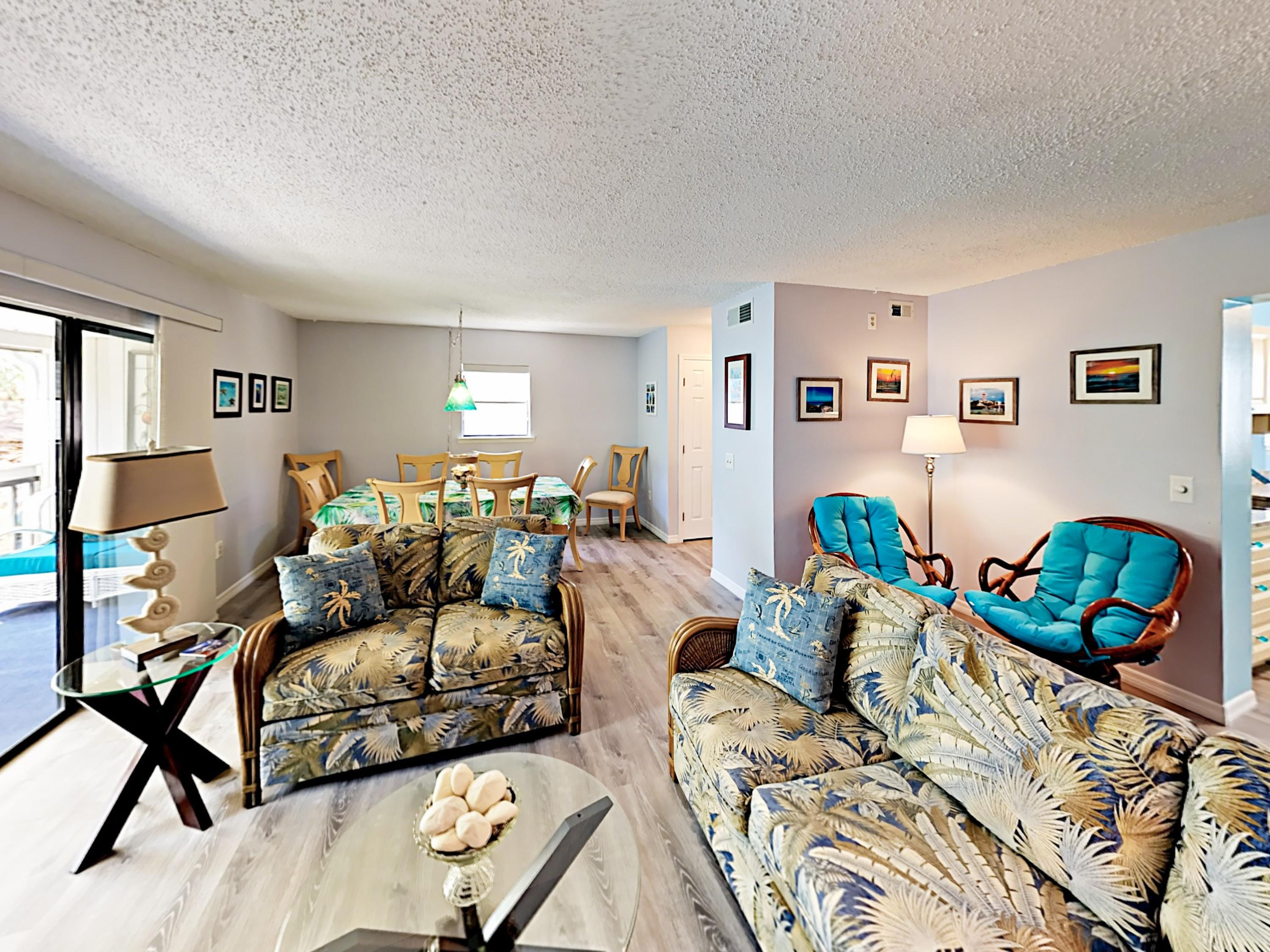Elegant Tommy Bahama decor in the living room. This welcoming condo is professionally managed by  TurnKey Vacation Rentals.