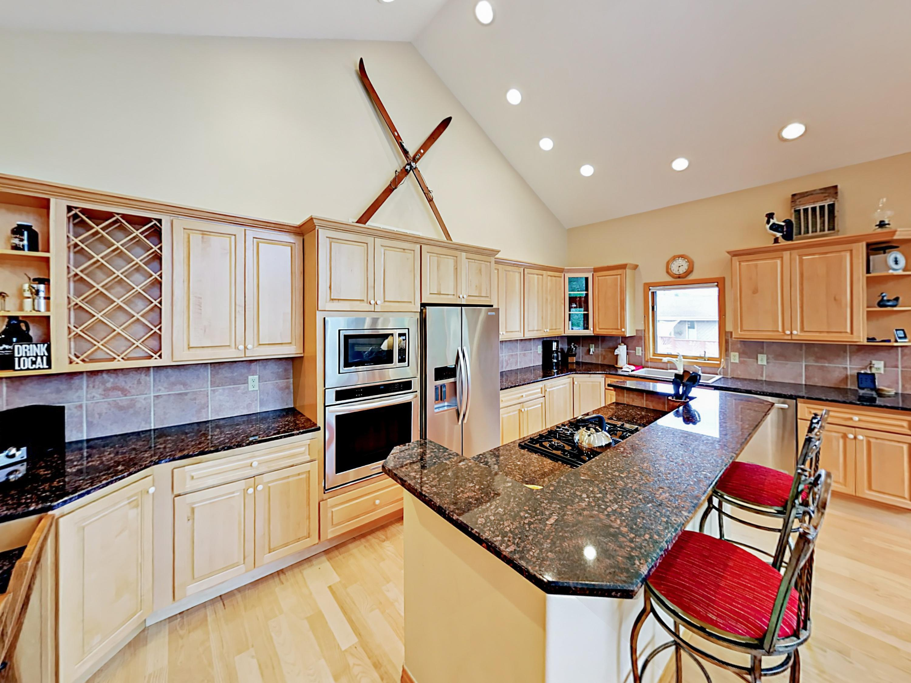The massive granite-lined kitchen has stainless steel appliances and a 2-person breakfast bar.