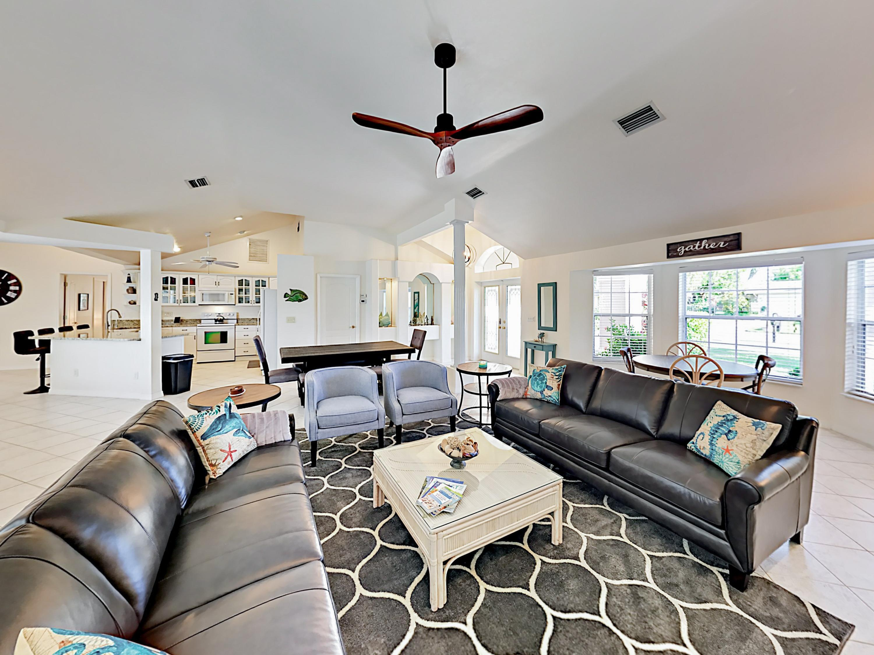 The main living area offers ample seating with a pair of couches and 2 armchairs.