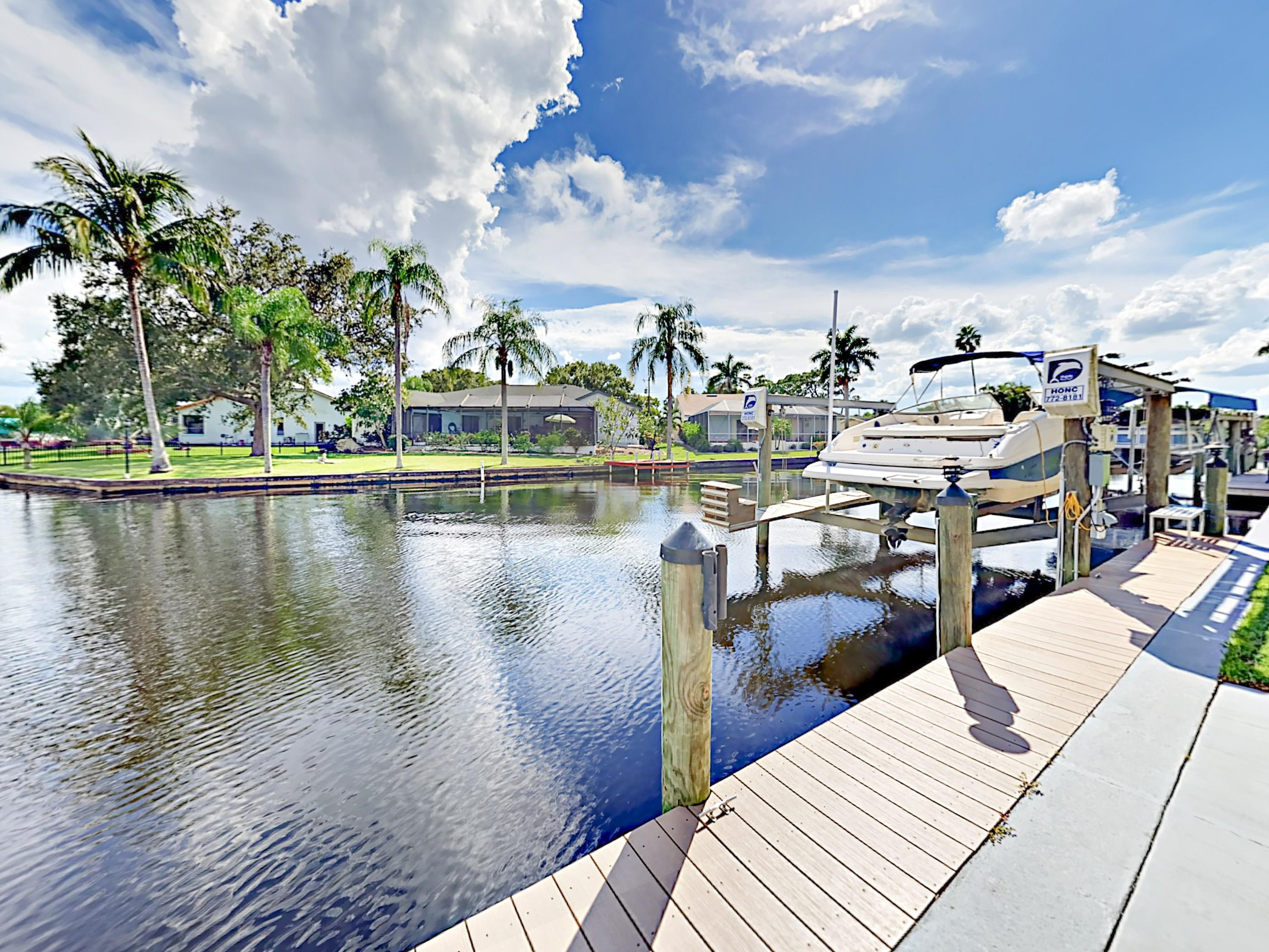 This stunning canalfront home boasts a private dock.
