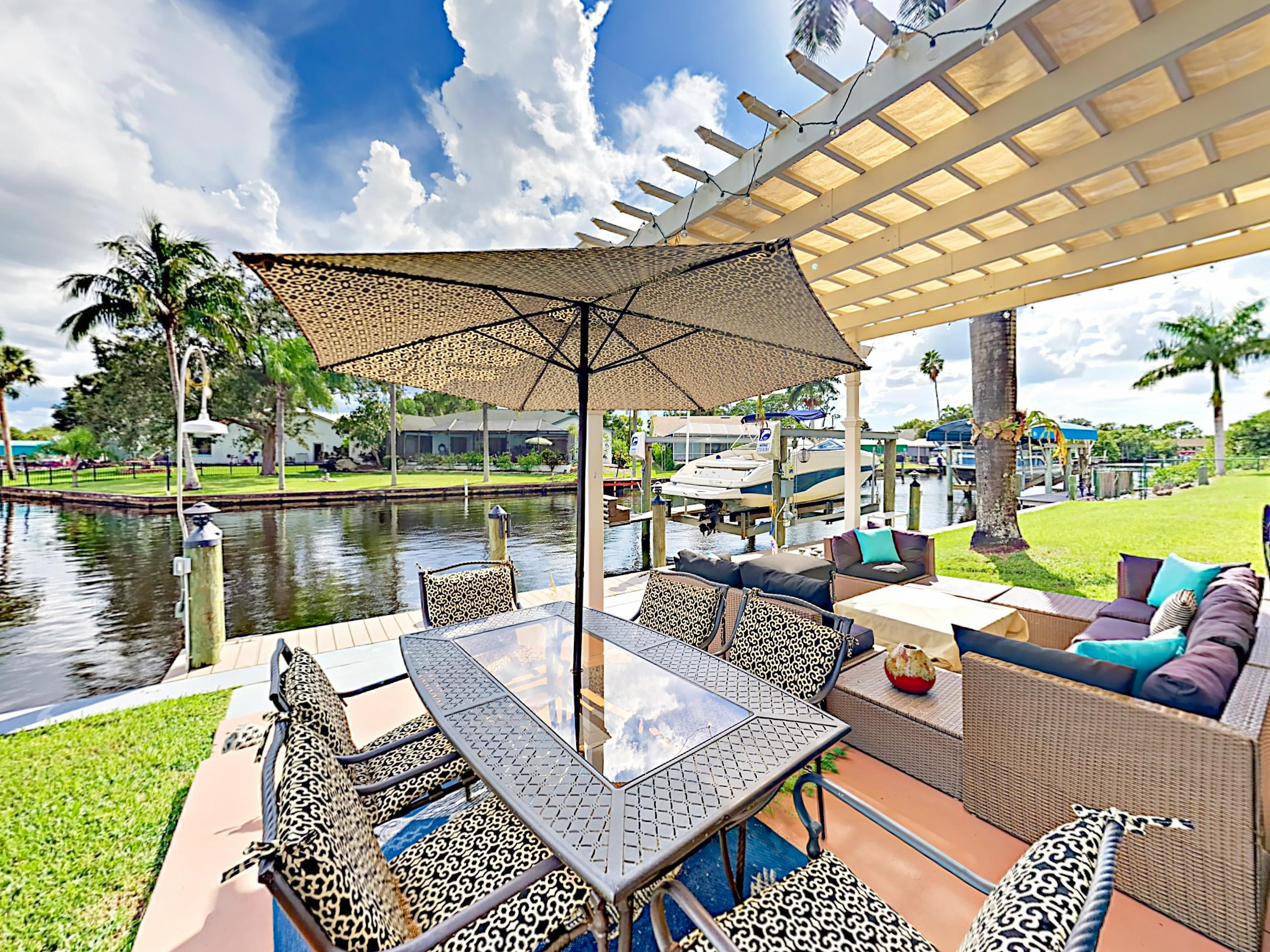 Welcome to North Fort Myers! Unwind on the patio, which features a fire pit and a table with seating for 6.