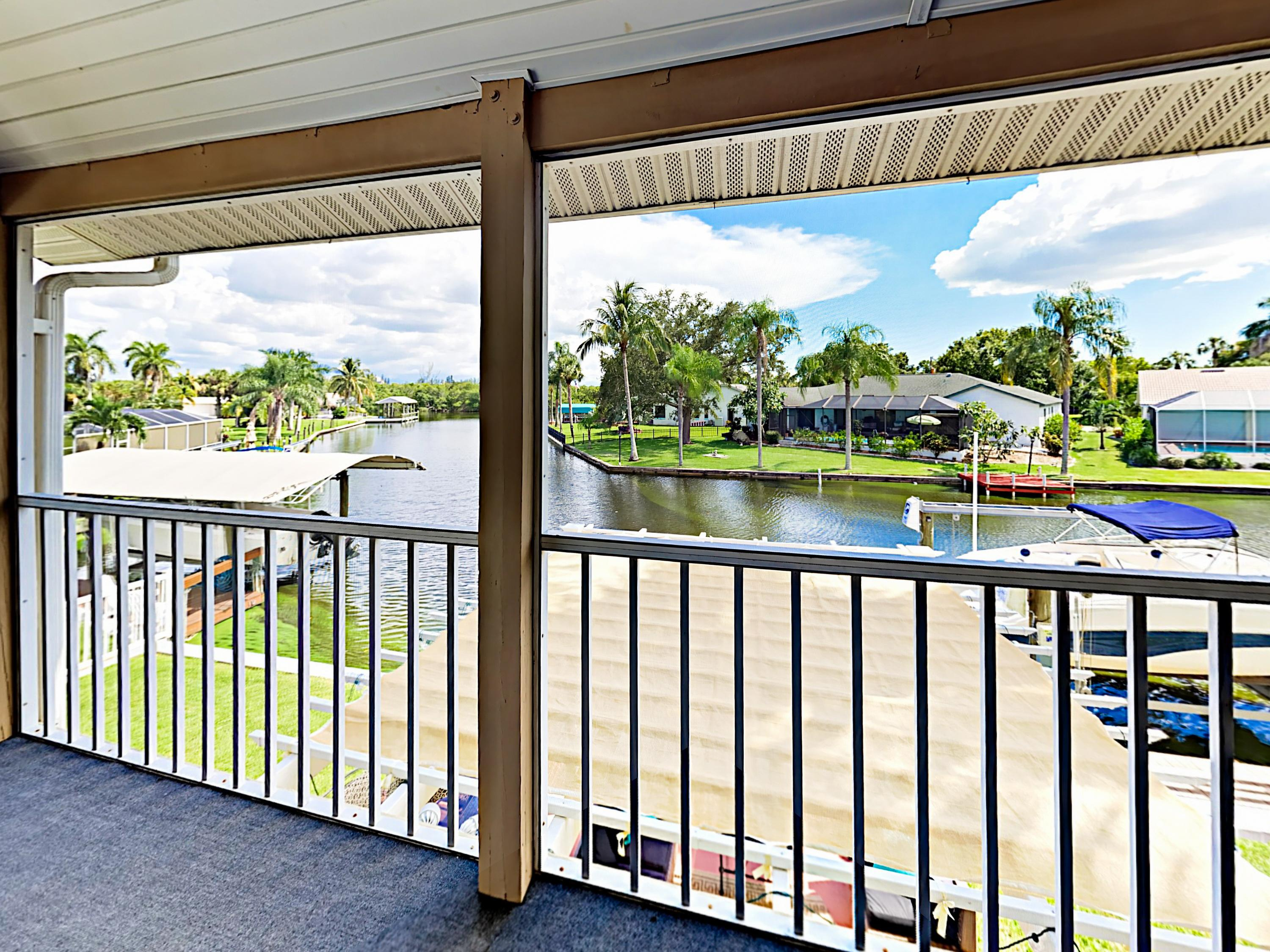 Enjoy the fresh air out on the screened lanai.