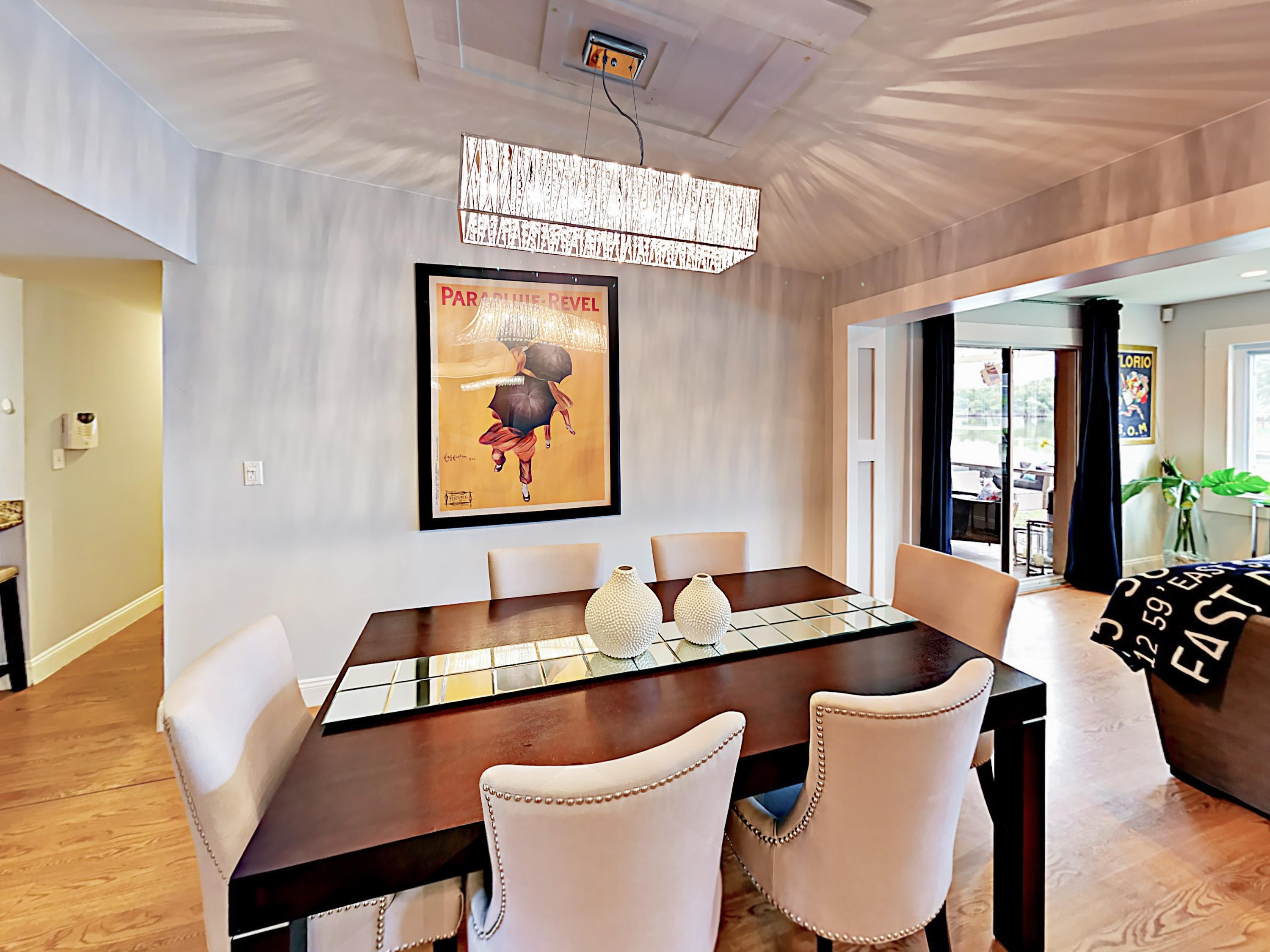 In the downstairs unit, a dining table can accommodate 6 people.