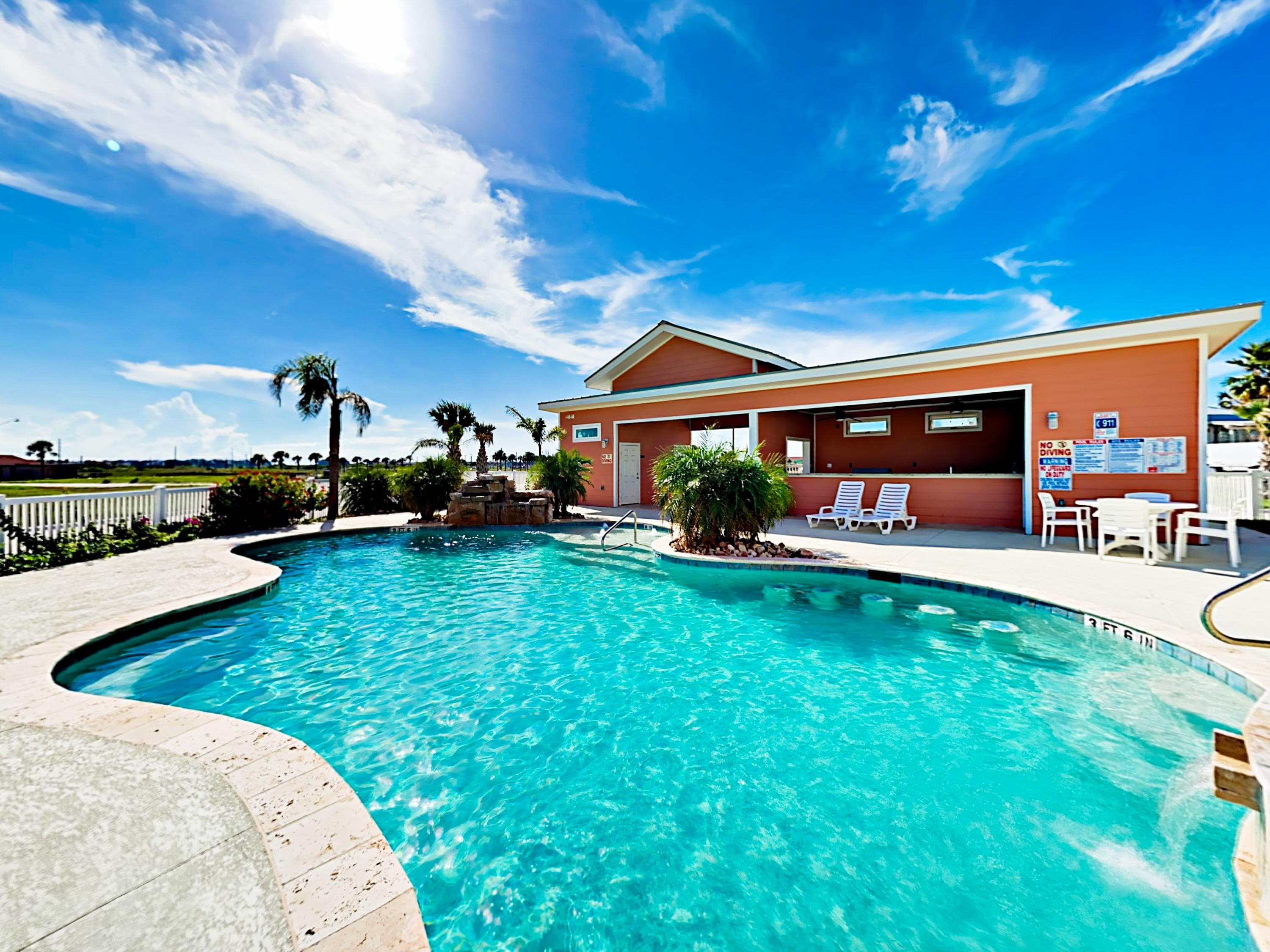 Cool off in the sparkling shared pool. This property is professionally managed by TurnKey Vacation Rentals.
