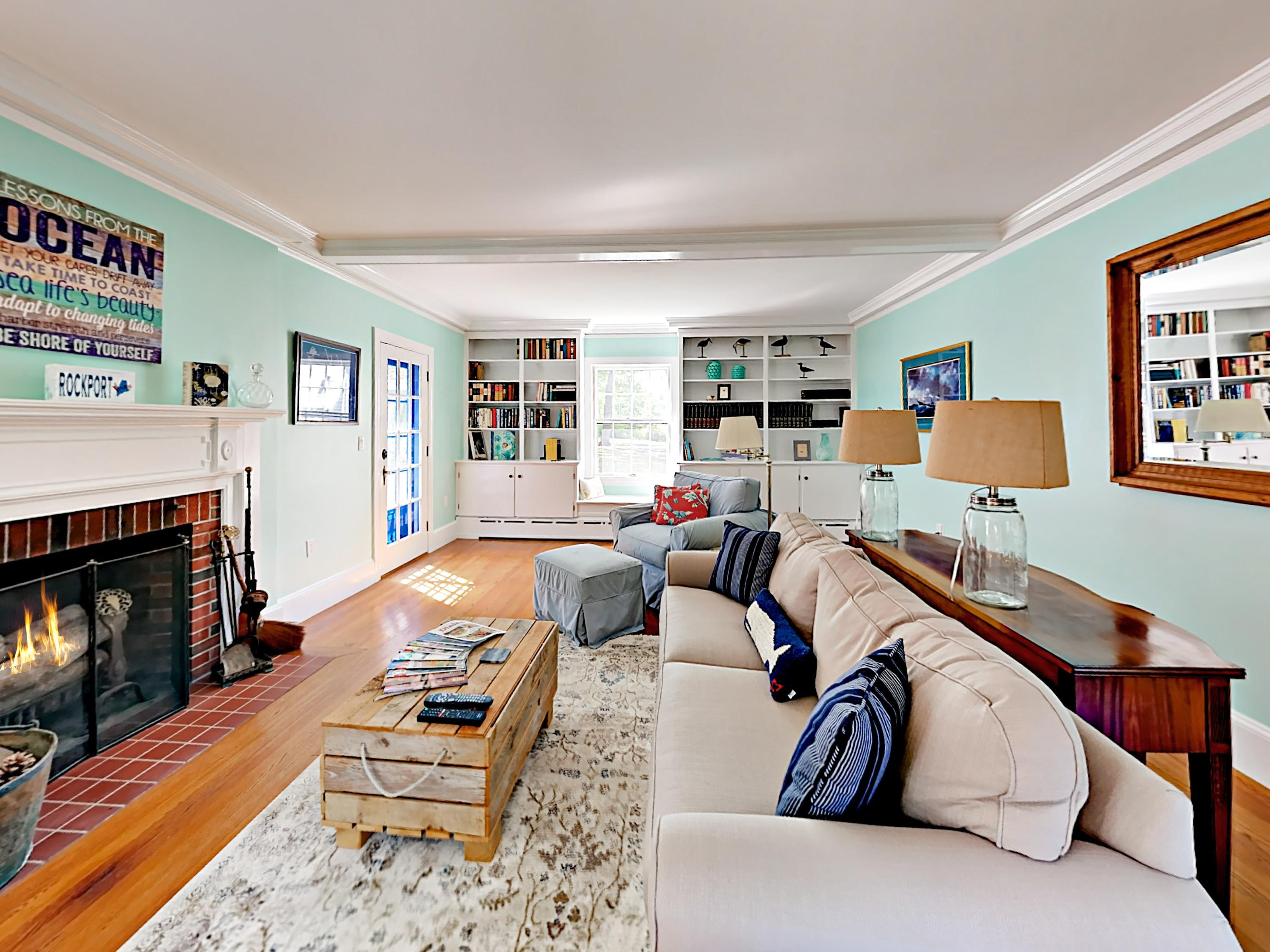 Oceanic colors welcome you into the living room, where a sofa and armchair offer seating for 4.